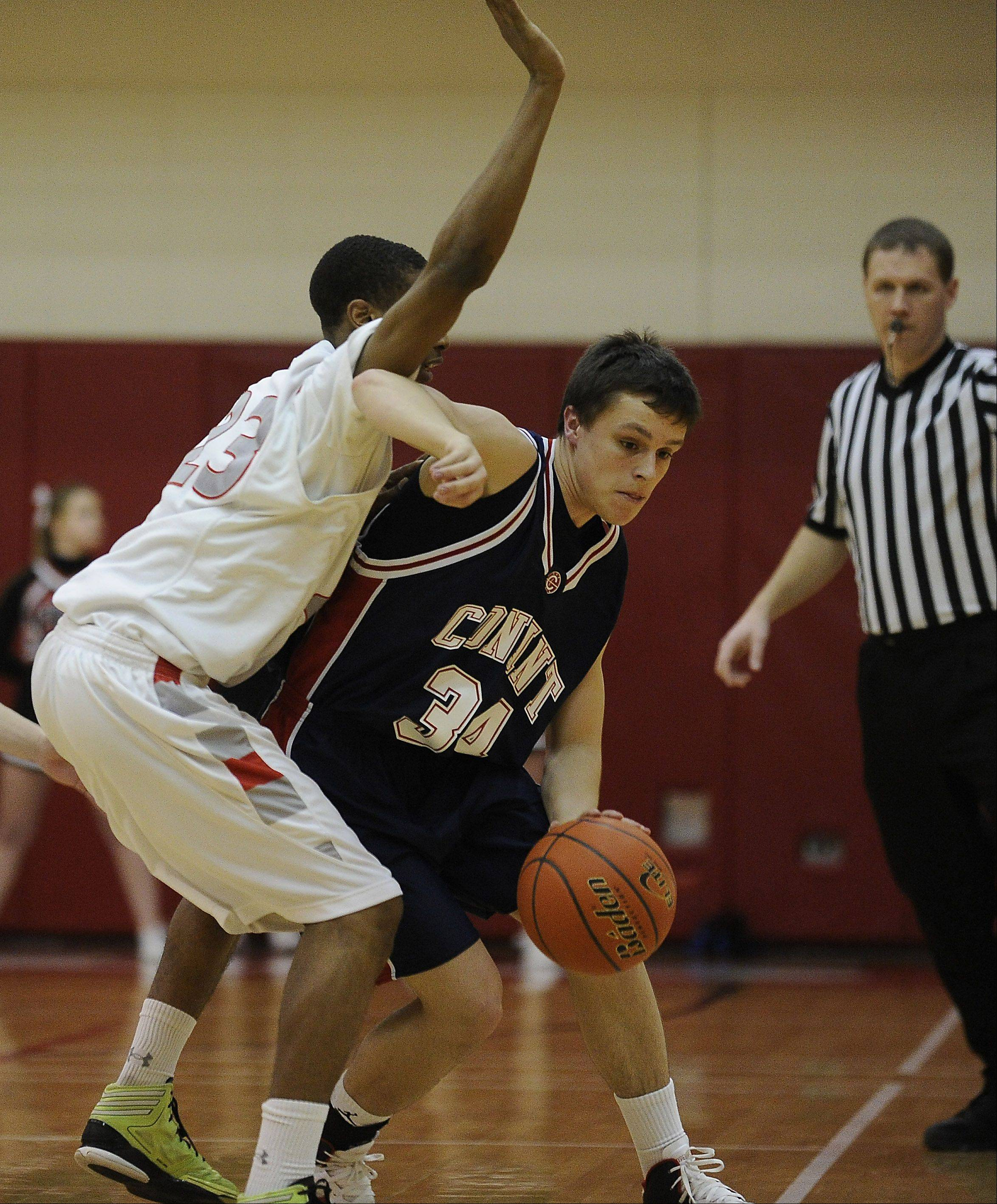 Conant�s Mark Monti drives past Palatine�s Roosevelt Smart in the first half of MSL West play Thursday at Palatine.