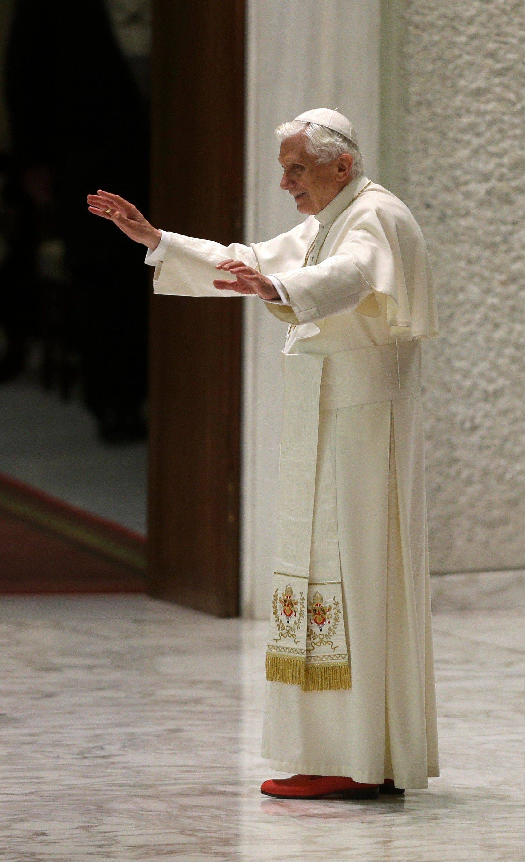 Pope Benedict XVI leaves after his weekly general audience in the Paul VI hall at the Vatican.