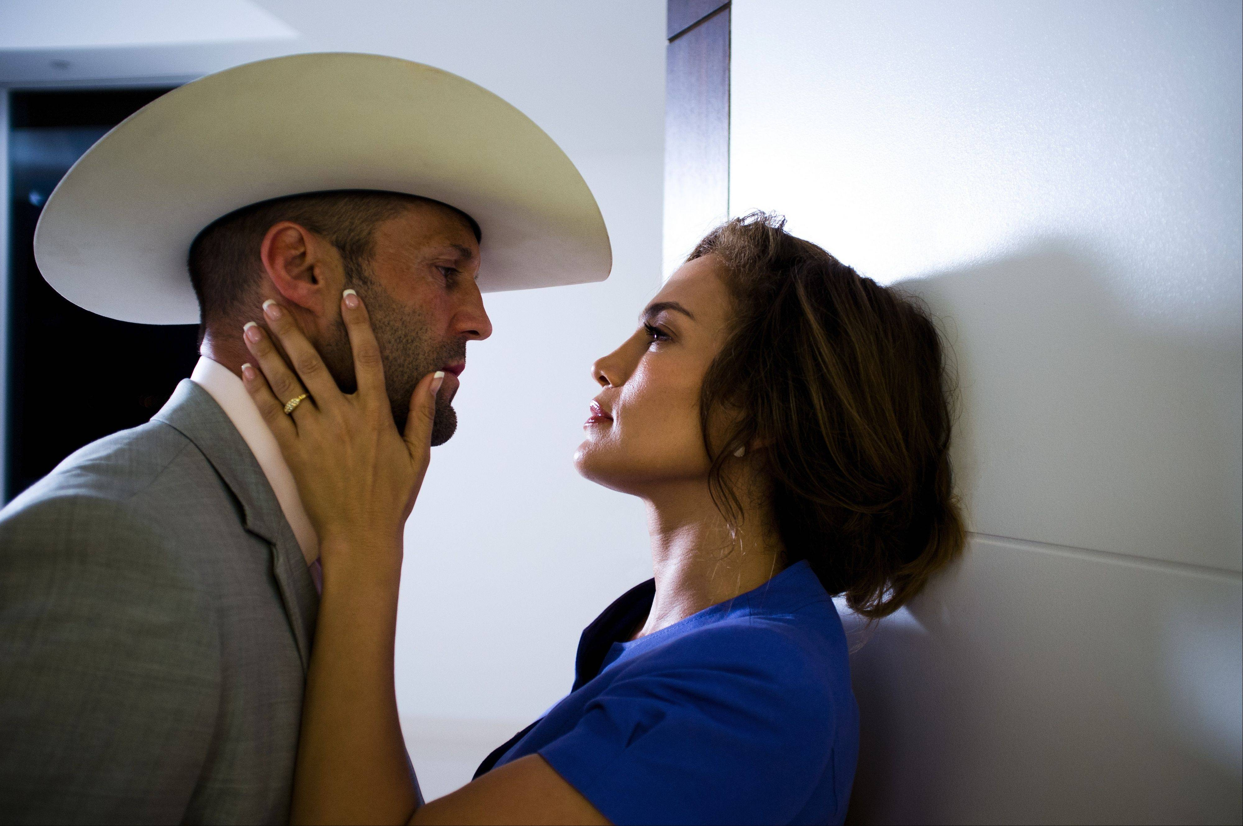 "A thief (Jason Statham) for revenge teams up with a real estate agent (Jennifer Lopez) in the crime thriller ""Parker"" based on Donald Westlake's detective novels."