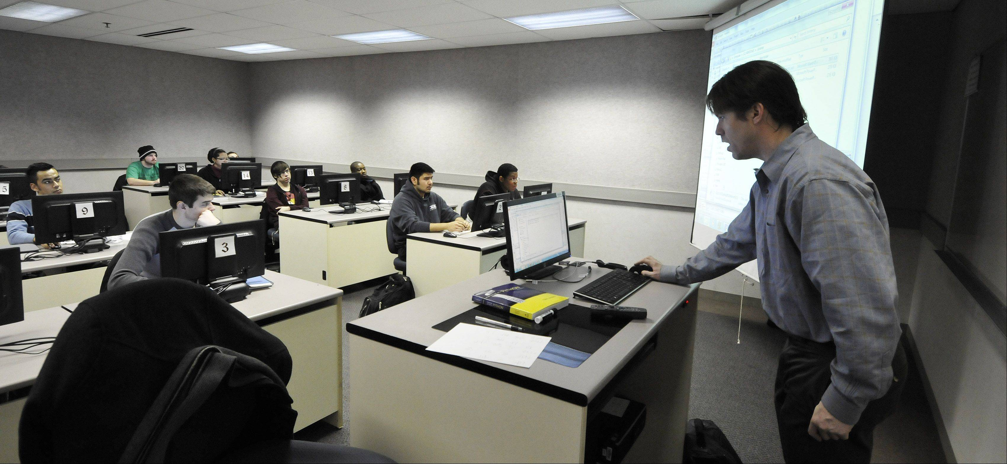Tim Moriarty teaches an introductory computer programming class at Waubonsee Community College in Sugar Grove. Waubonsee is participating in the Aurora Regional Pathways to Prosperity Project, an initiative launched Friday to develop better paths into careers in health care, manufacturing and information technology for area students.