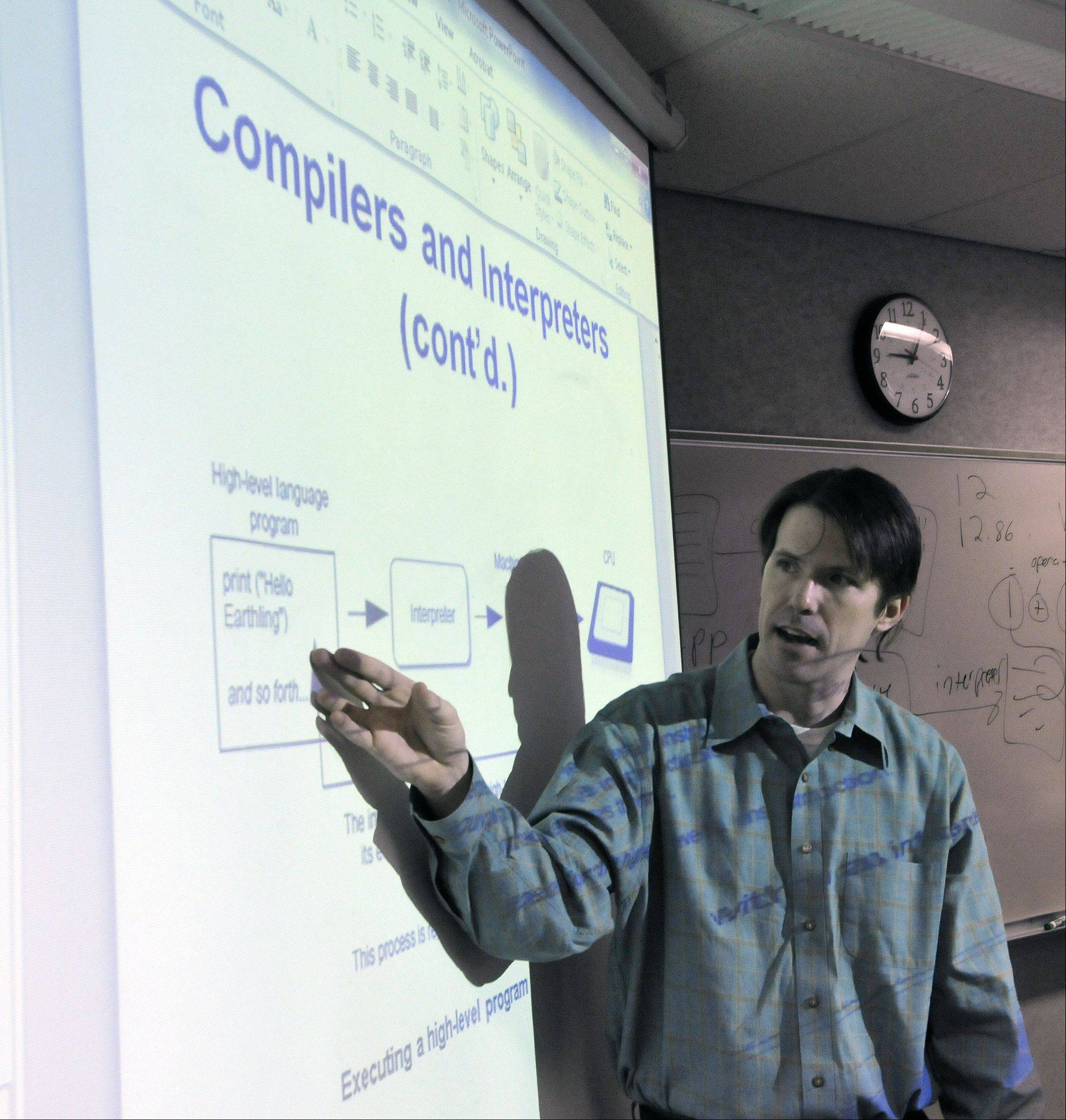 Tim Moriarty teaches an introductory computer programming class at Waubonsee Community College in Sugar Grove. The college is one partner in the Aurora Regional Pathways to Prosperity Project, which launched Friday and aims to better connect area students with the training they need to enter high-demand fields such as information technology, health care and manufacturing.