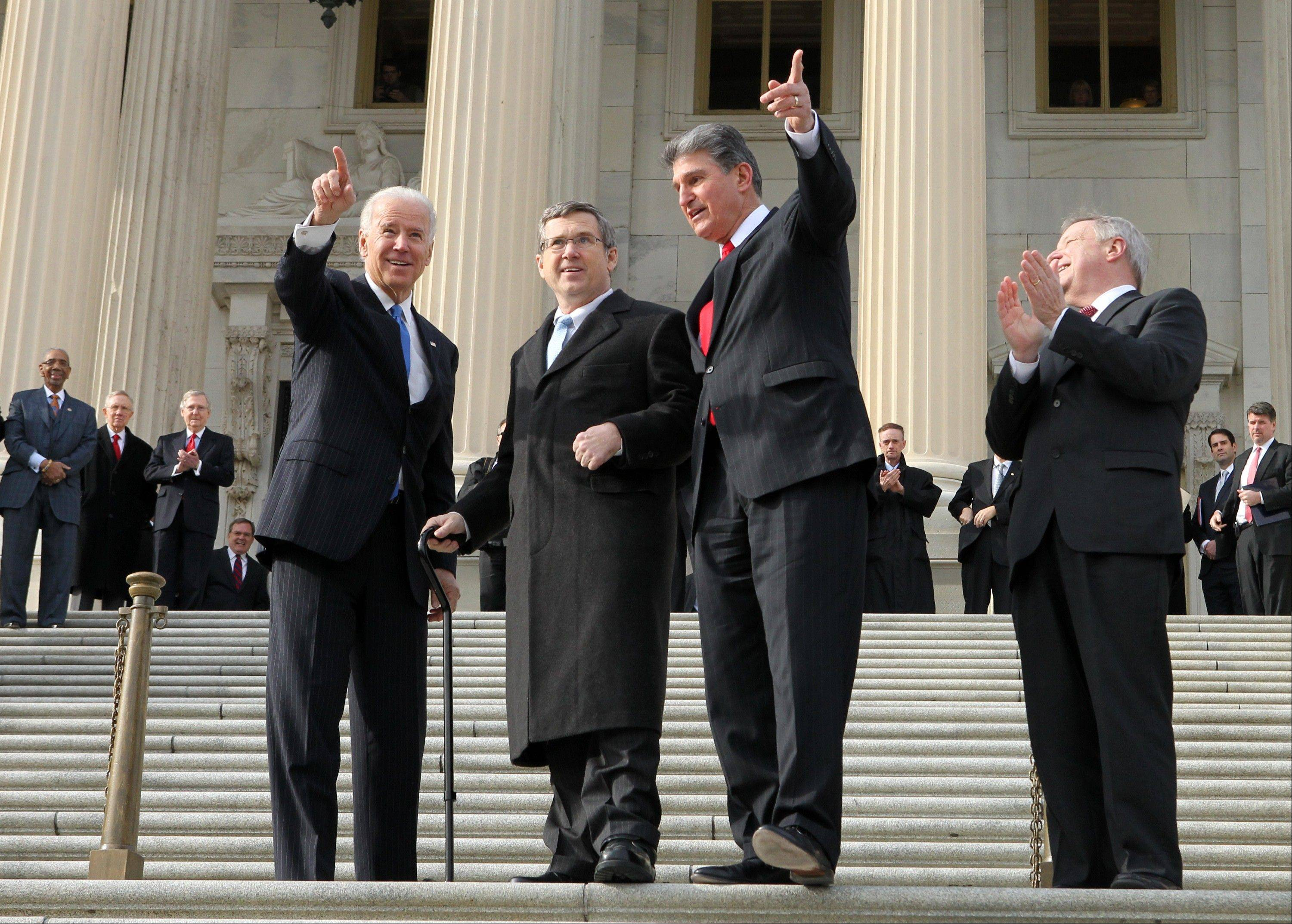 IMAGE DISTRIBUTED FOR REHABILITATION INSTITUTE OF CHICAGO - U.S. Senator Mark Kirk (R-IL), second from left, who participated in a clinical walking trial at the Rehabilitation Institute of Chicago following a massive stroke in January 2012, acknowledges the crowd of well-wishers as U.S. Vice President Joe Biden, left, Senators Joe Manchin (D-WV), center, and Dick Durbin (D-IL), right, walk with him up the Capitol building steps in Washington on Thursday, Jan. 3, 2013. Kirk hopes his recovery will serve as an inspiration to the millions of Americans recovering from stroke. (Paul Morigi / AP Images for Rehabilitation Institute of Chicago)