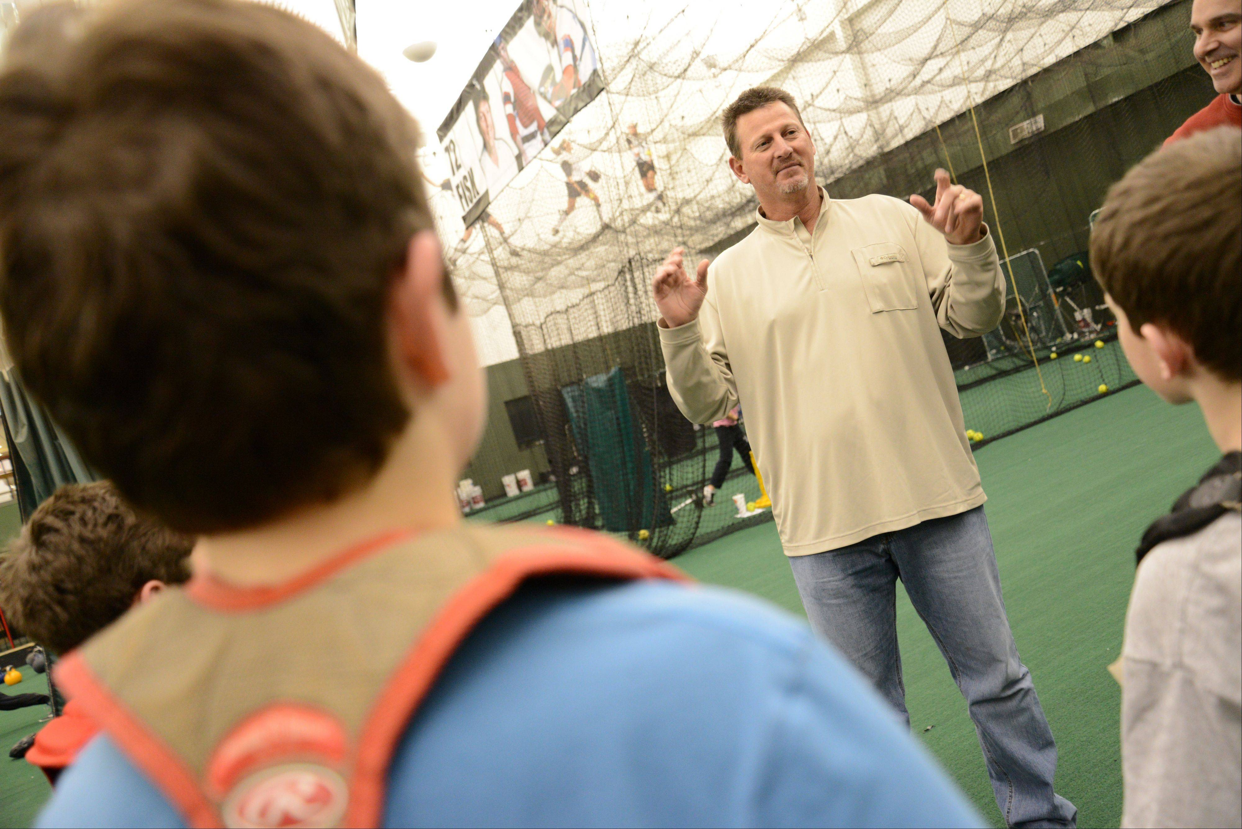 Coach Bobby Thigpen of the White Sox gives some ball tips to children at the Bulls/Sox Academy in Lisle.