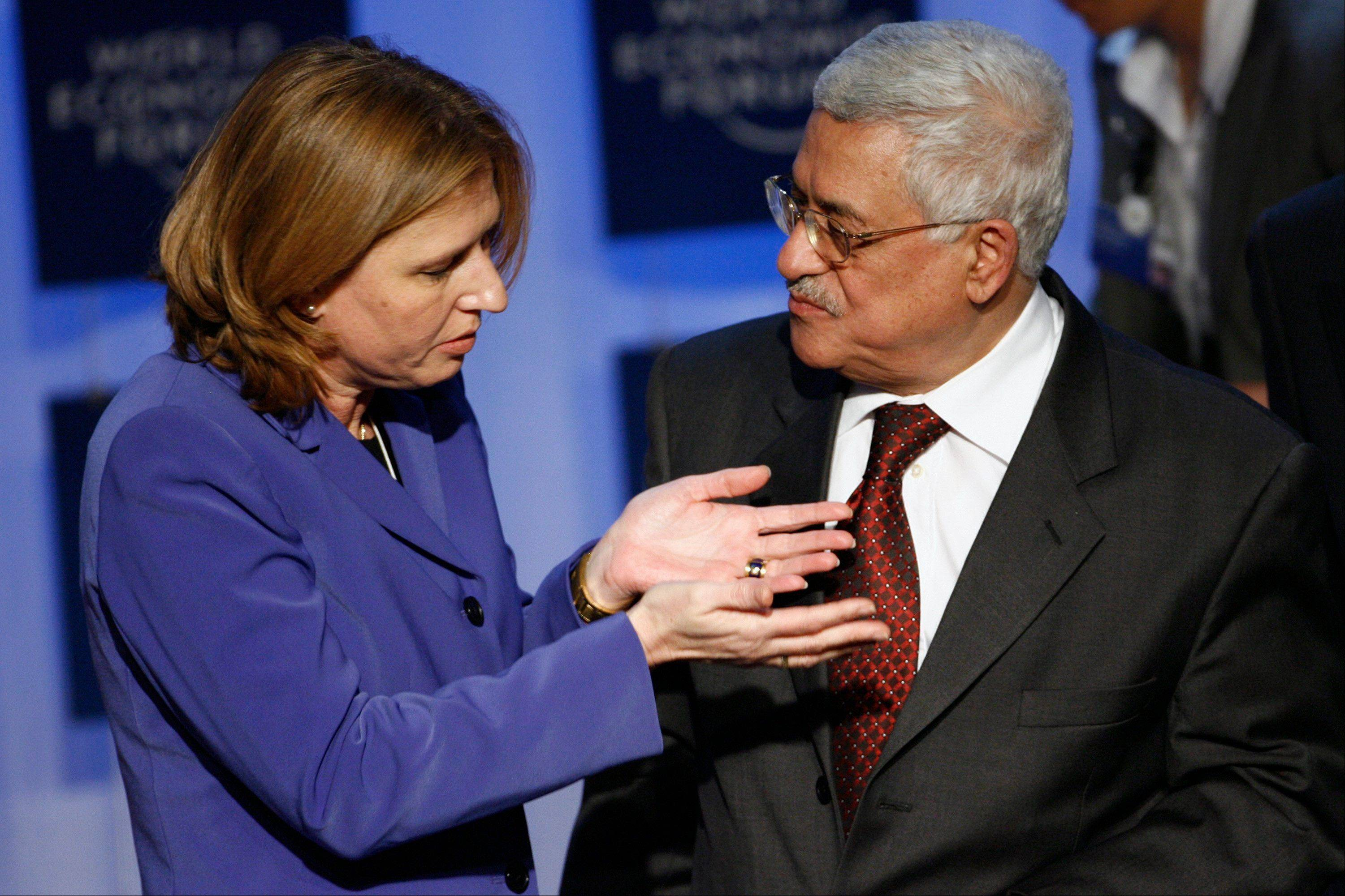 Israeli Foreign Minister Tzipi Livni, left, and President of the Palestinian Authority Mahmoud Abbas meet during the World Economic Forum in Davos, Switzerland, in 2007. The Palestinian president will invite Israeli politicians to the West Bank to try to make sure peacemaking is on the new government's agenda, a senior official said Thursday.
