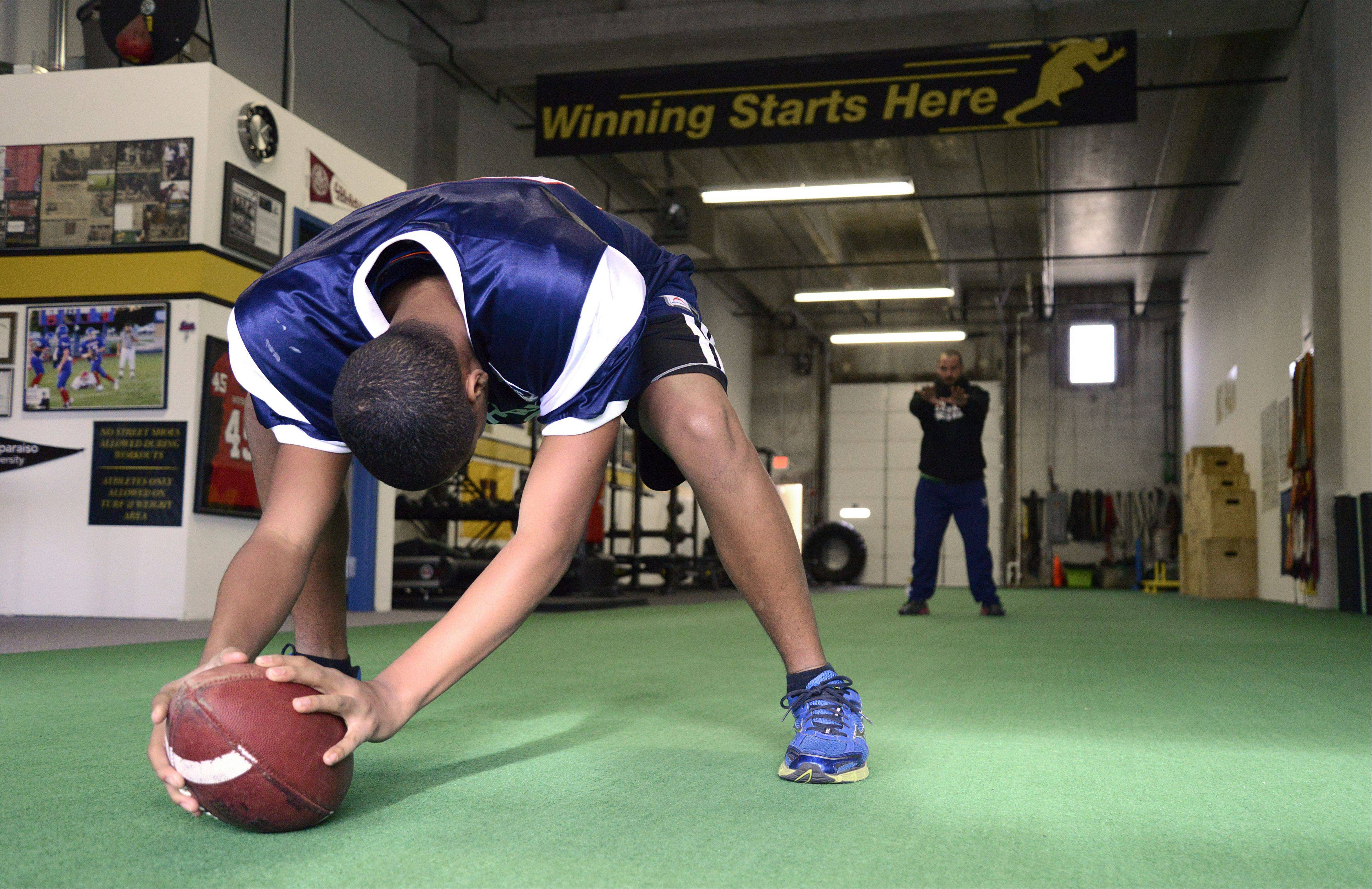 John Davis Jr. of South Elgin practices with Speed School trainer and owner, Joe Giustino, twice a week in St. Charles. John is among the nation's best football long snappers in his age group. He played in the 2013 JuniorRank Academic All-American Game on Jan. 4 in Carson, Calif.