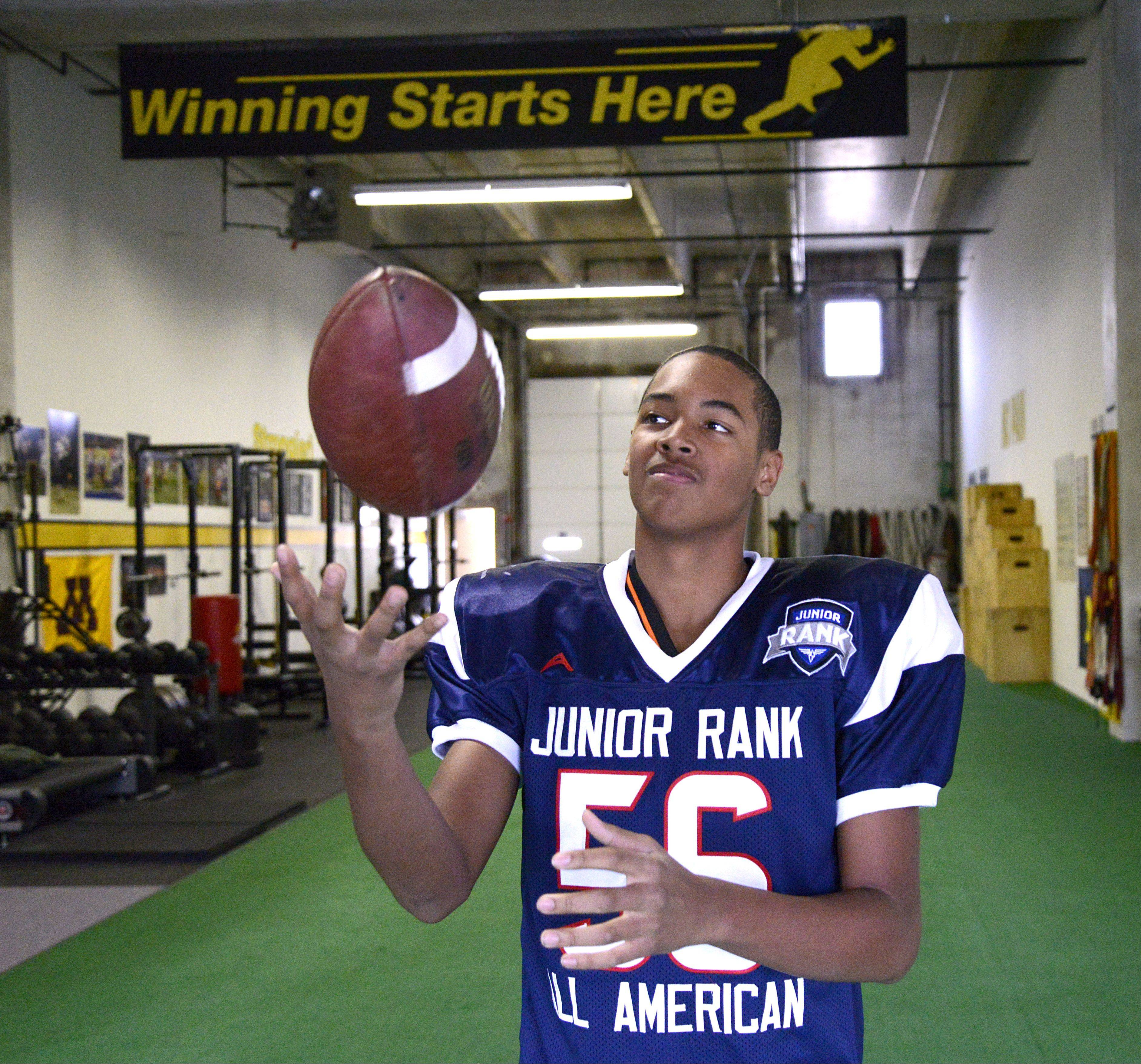 John Davis Jr. of South Elgin practices with Speed School trainer and owner, Joe Giustino, twice a week in St. Charles. John played in the 2013 JuniorRank Academic All-American Game on Jan. 4 in Carson, Calif.