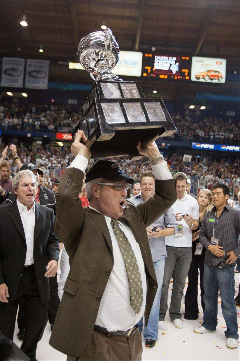 Winning championships has been part of Don Levin's formula for success. Here the Wolves owner raises the Calder Cup trophy, one of four titles his teams have collected.