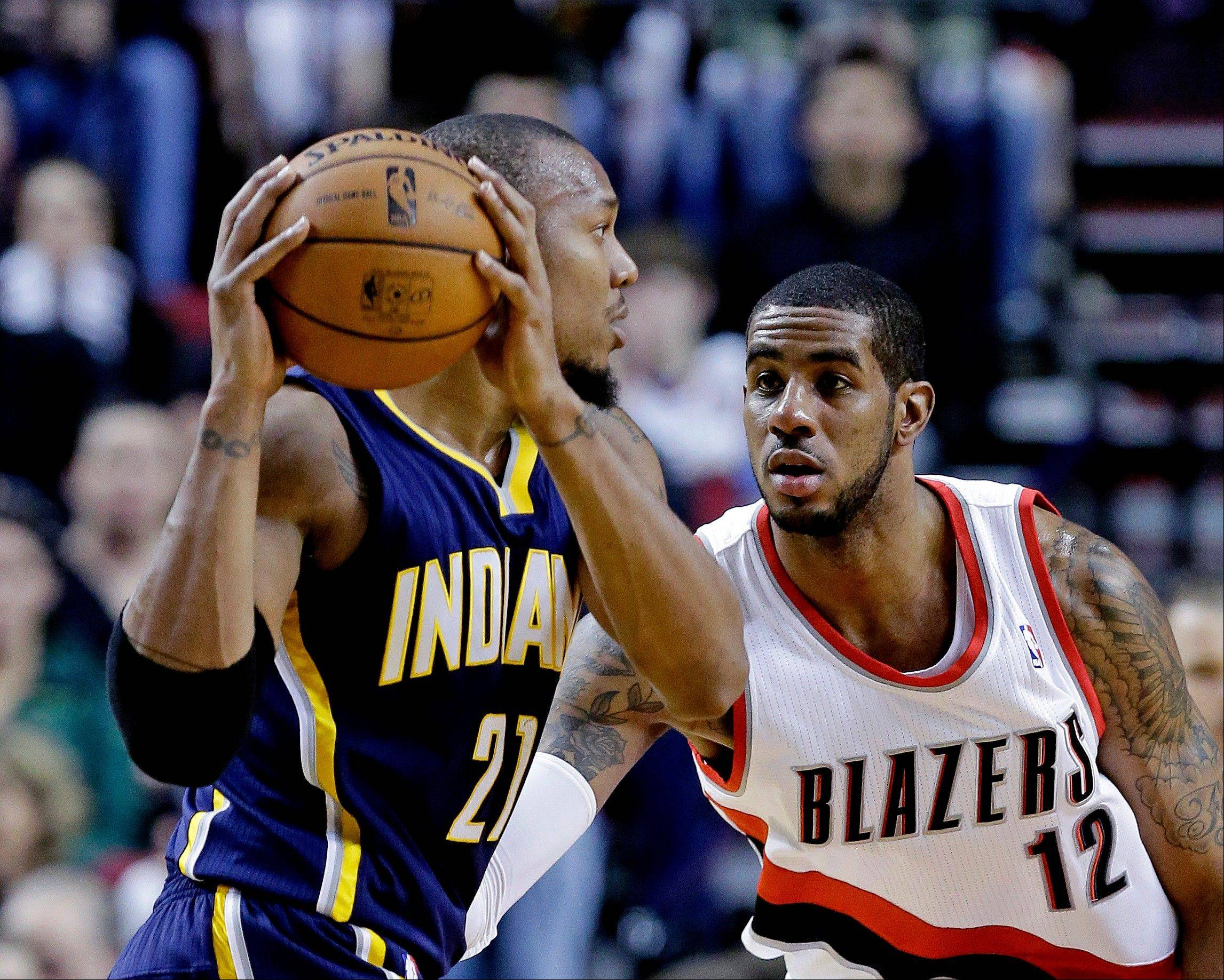 Portland Trail Blazers forward LaMarcus Aldridge, right, defends Indiana Pacers forward David West during the first quarter of an NBA basketball game in Portland, Ore., Wednesday, Jan. 23, 2013.