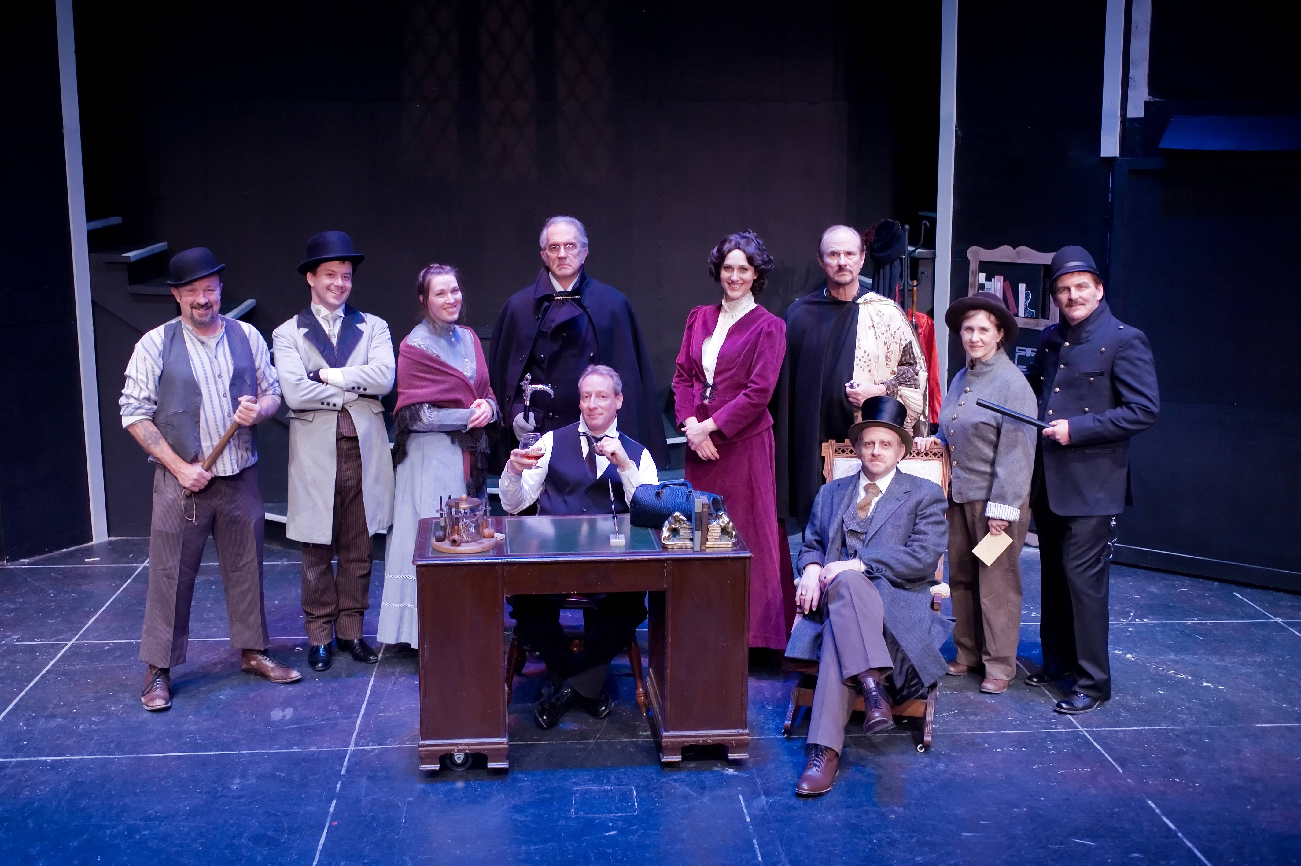 "The cast of ""Sherlock Holmes: The Final Adventure"" at Wheaton Drama. From left, back row, Roy Birch, Edward Barnett, Karen Neidlinger, Larry Mayo, Sharon Voss, Tom Viskocil, Amy Johnson, Pat Day, and front row, Deven Ferber and Harold LeBoyer."