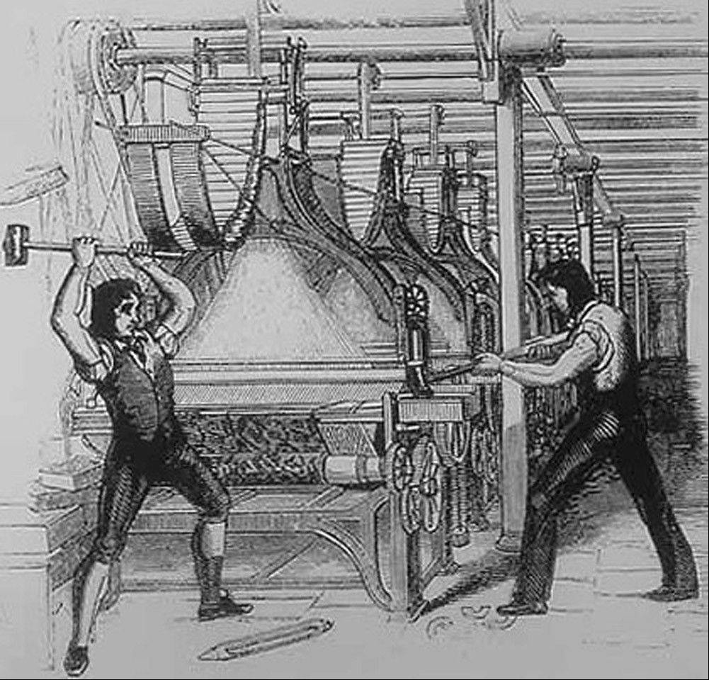 This publicly distributed illustration from 1812 shows frame-breakers, or Luddites, smashing a loom.