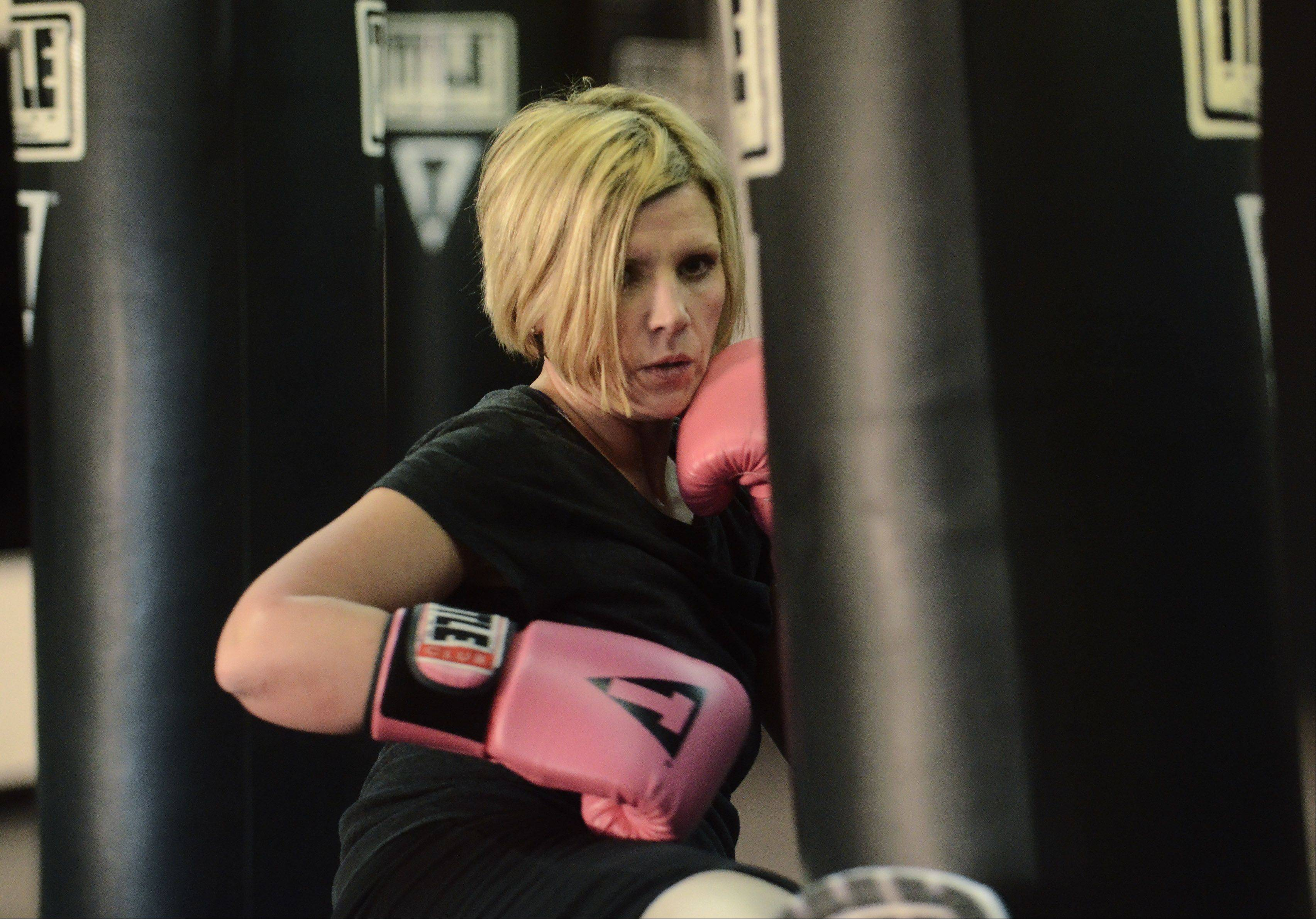 Erin Alsakhria works out during a Power Hour class at Title Boxing Club in Schaumburg.