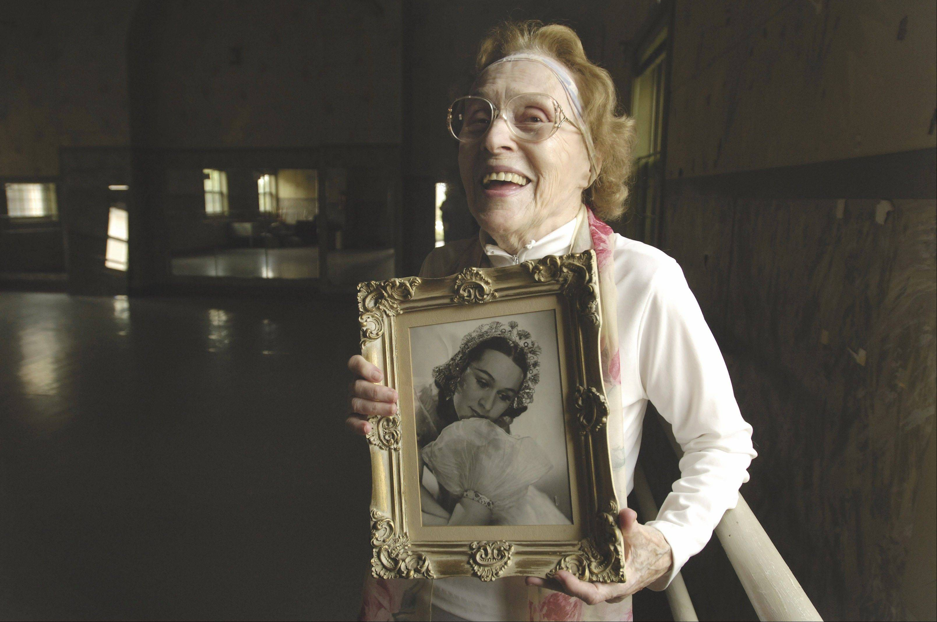 Lisa Boehm holds a portrait of herself when she was a young ballerina in this 2005 photo.