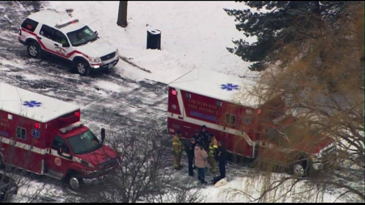 Emergency personnel respond to the scene of an ice rescue near Vernon Hills on Friday.
