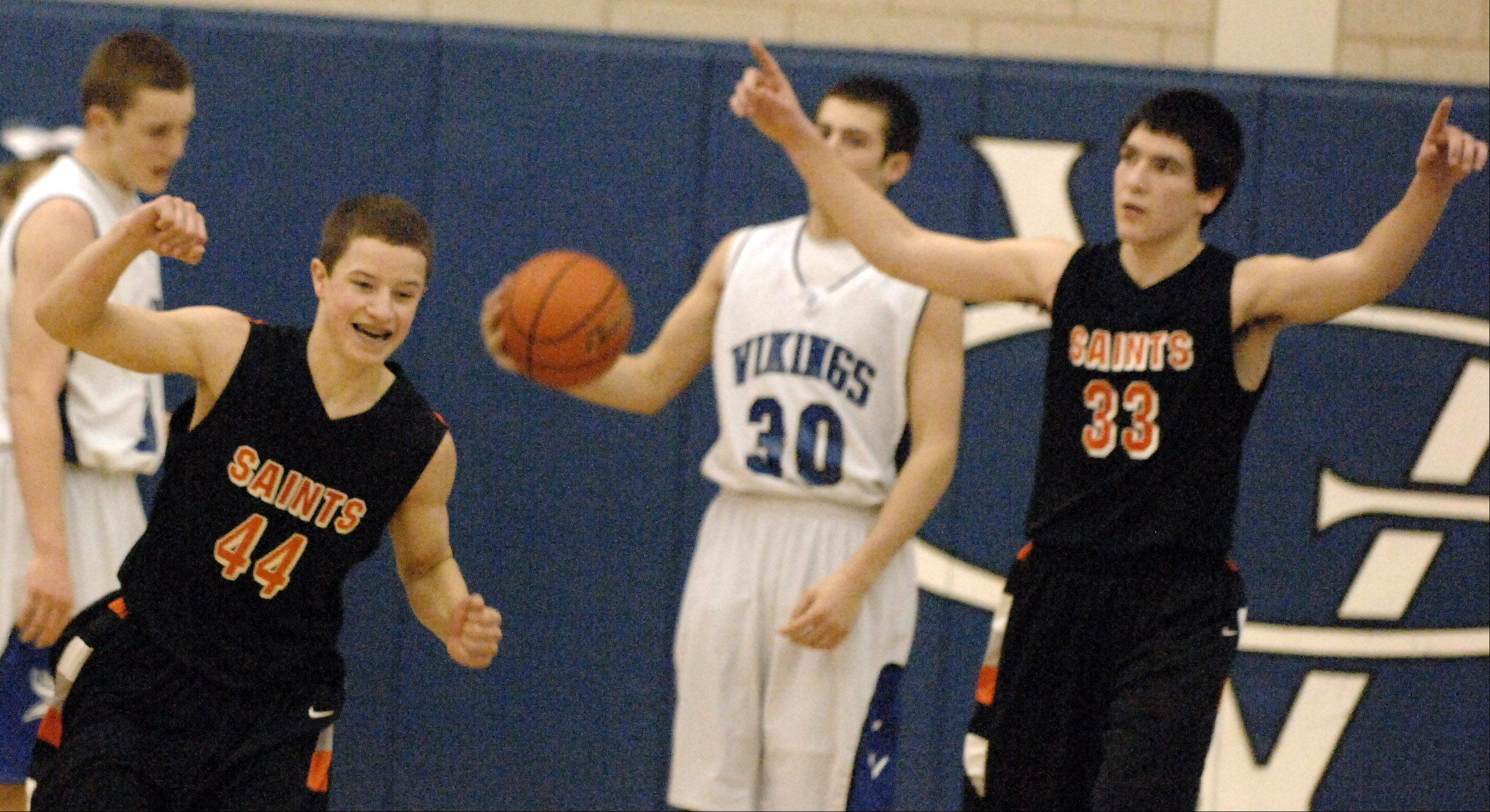 St. Charles East�s Cole Gentry and Jake Asquini celebrate their double-overtime win.
