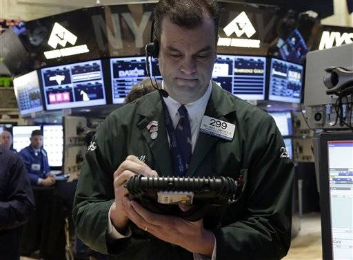 rader William Lawrence works on the floor of the New York Stock Exchange, Friday. The Standard & Poor's 500 index closed above 1,500 on Friday for the first time since the start of the Great Recession in 2007, lifted by strong earnings from Procter & Gamble and Starbucks.