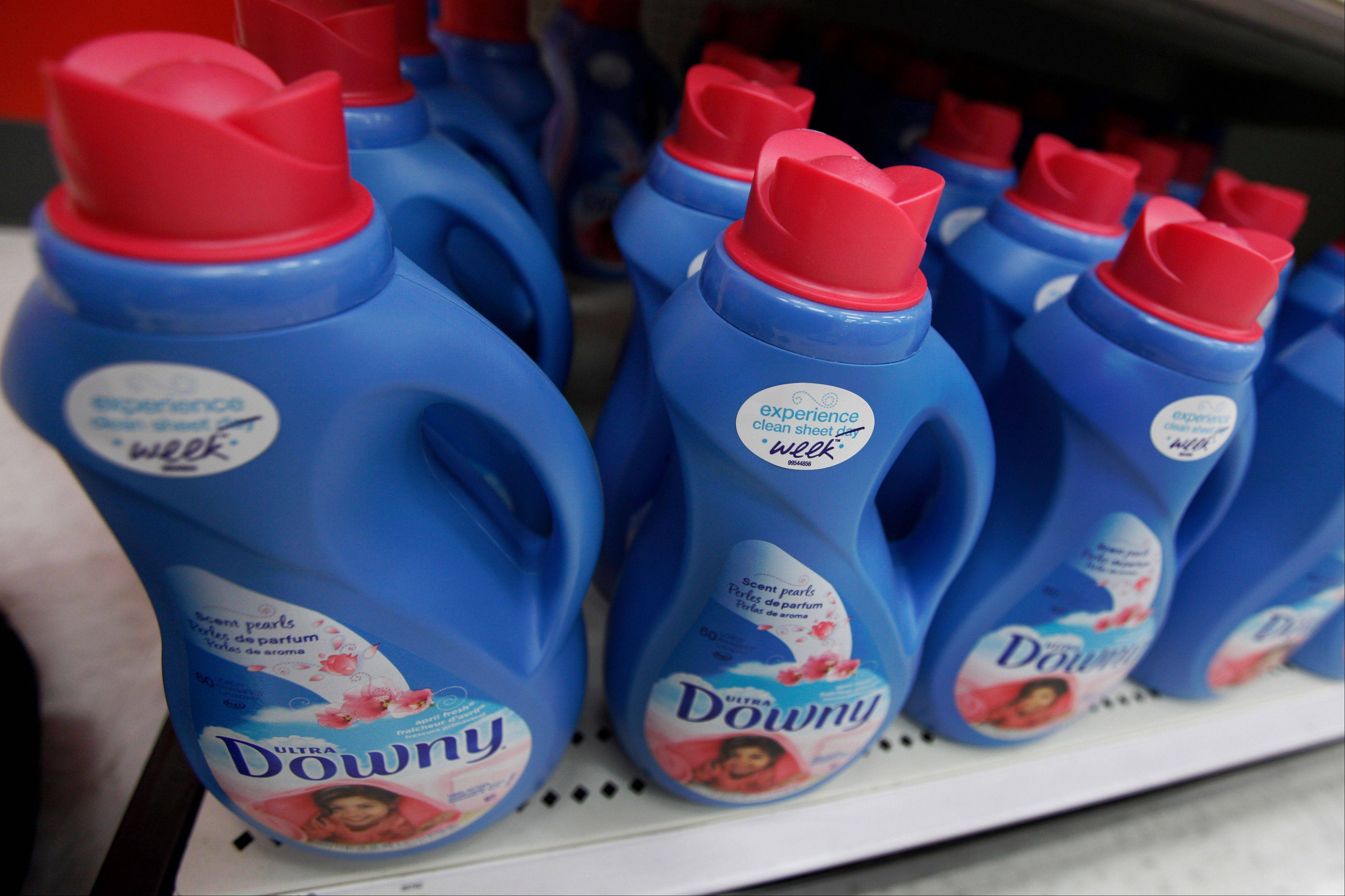 Procter & Gamble said Friday that its fiscal second quarter net income more than doubled and boosted its profit outlook as the maker of Tide and Pampers took back market share.