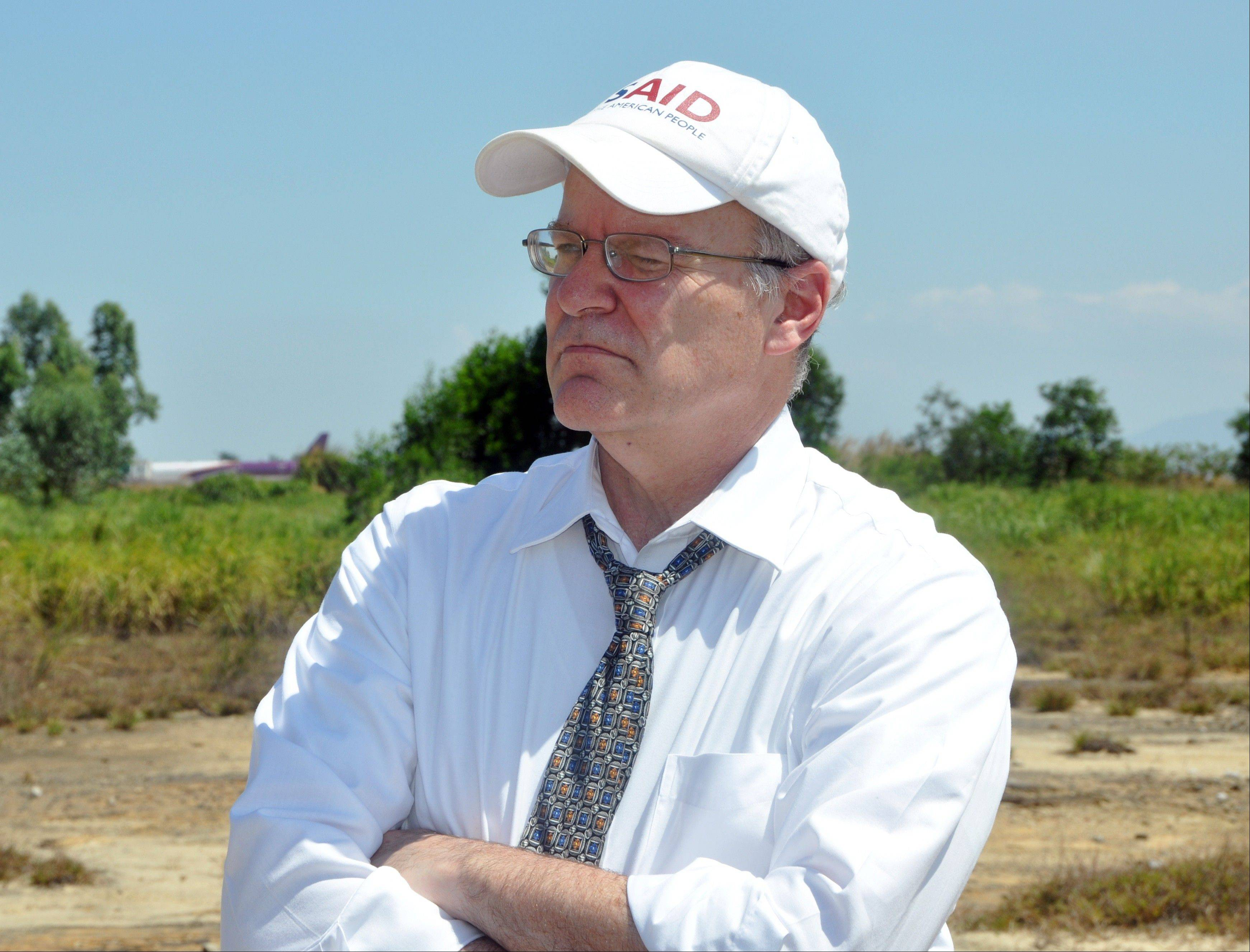 Deputy USAID administrator Donald Steinberg tours the Danang Airport in Vietnam.