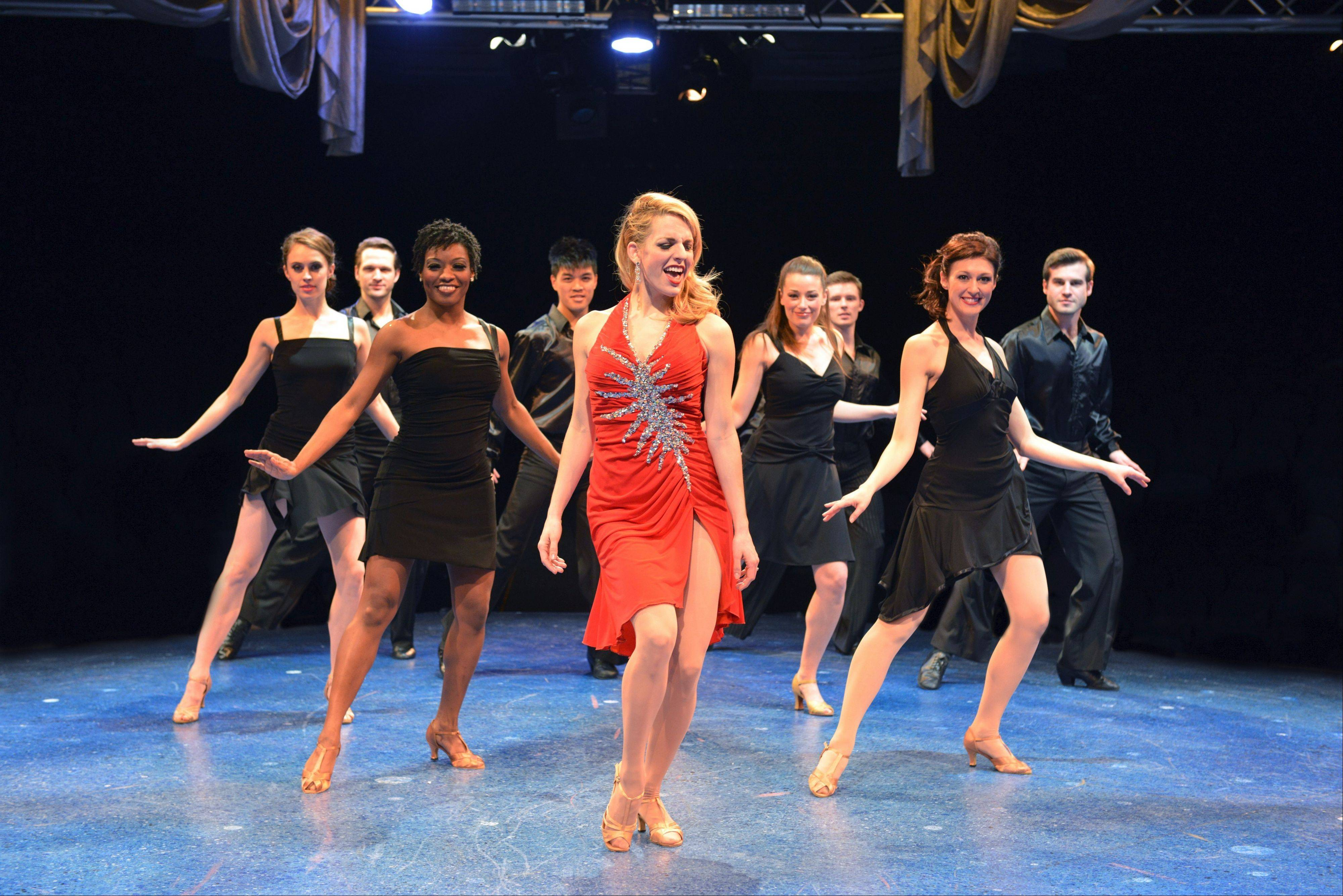 "Stephanie Binetti (in red) leads the ensemble in the production number ""Buenos Aires"" from ""Evita"" in the world premiere revue ""Now & Forever: The Music of Andrew Lloyd Webber"" at the Marriott Theatre in Lincolnshire."