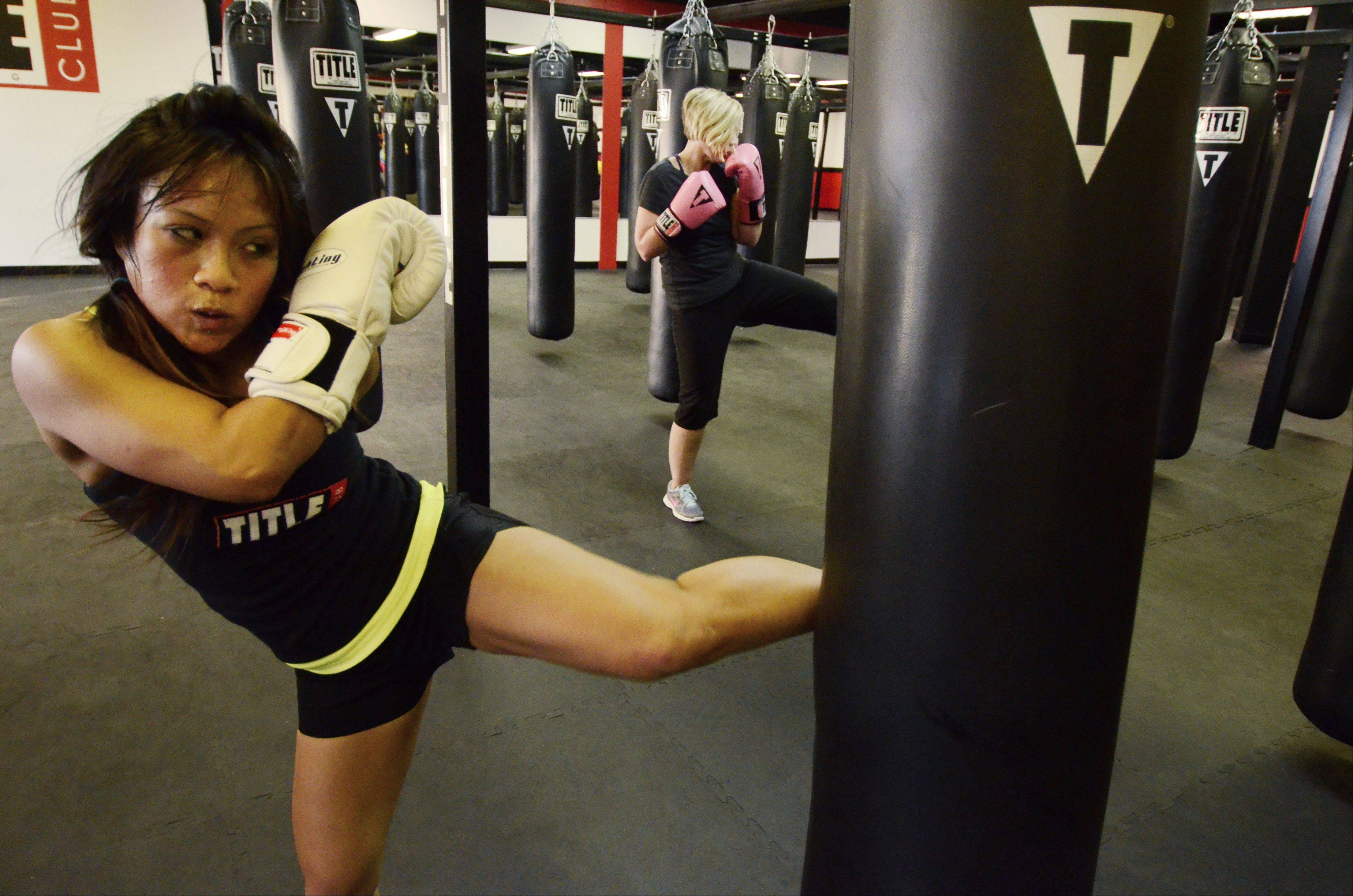 Trainer Cher Nicolas works out at Title Boxing Club in Schaumburg.