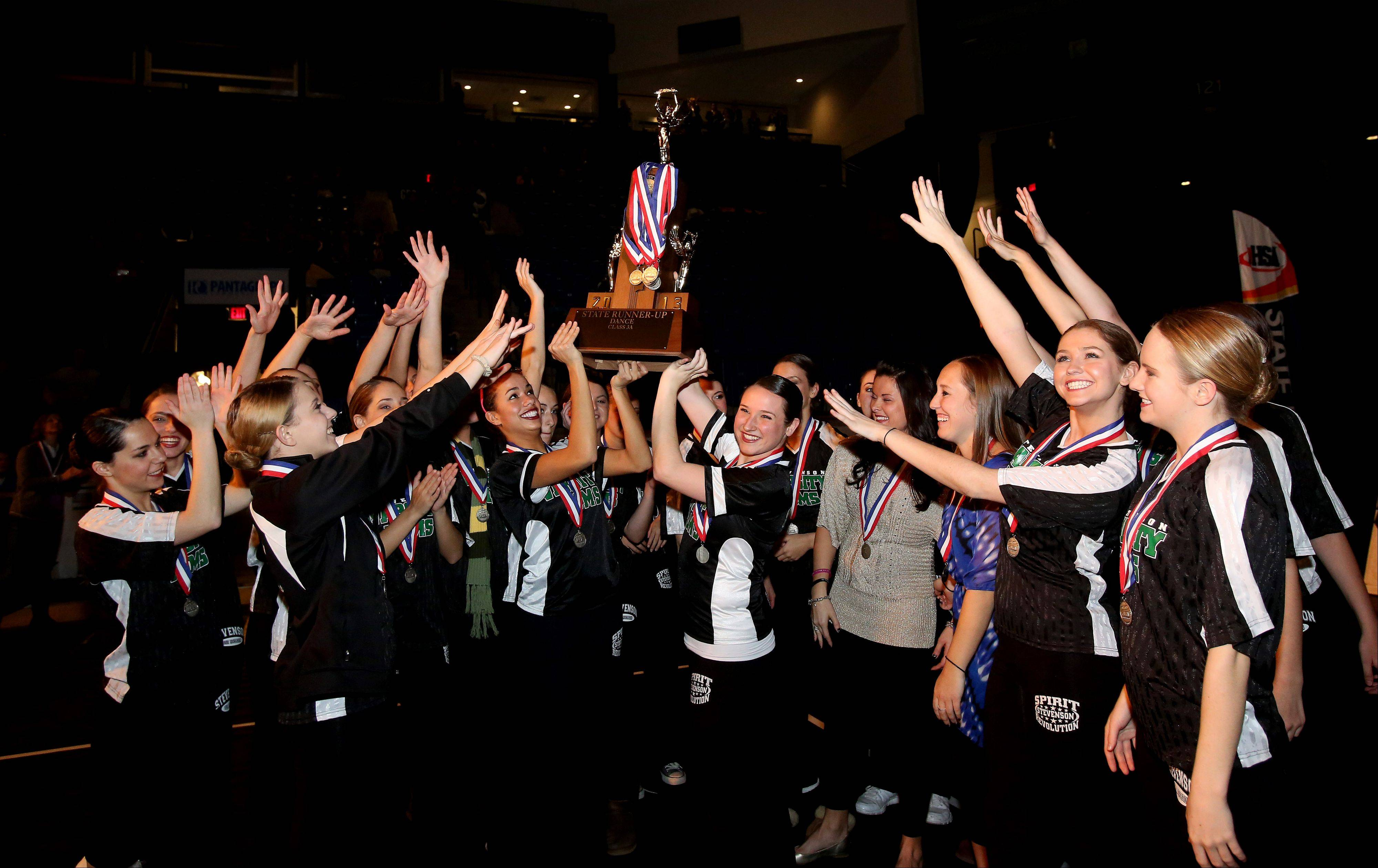 Stevenson HIgh School holds up its second place trophy in the 3A division of the Competitive Dance State Finals on Saturday in Bloomington.