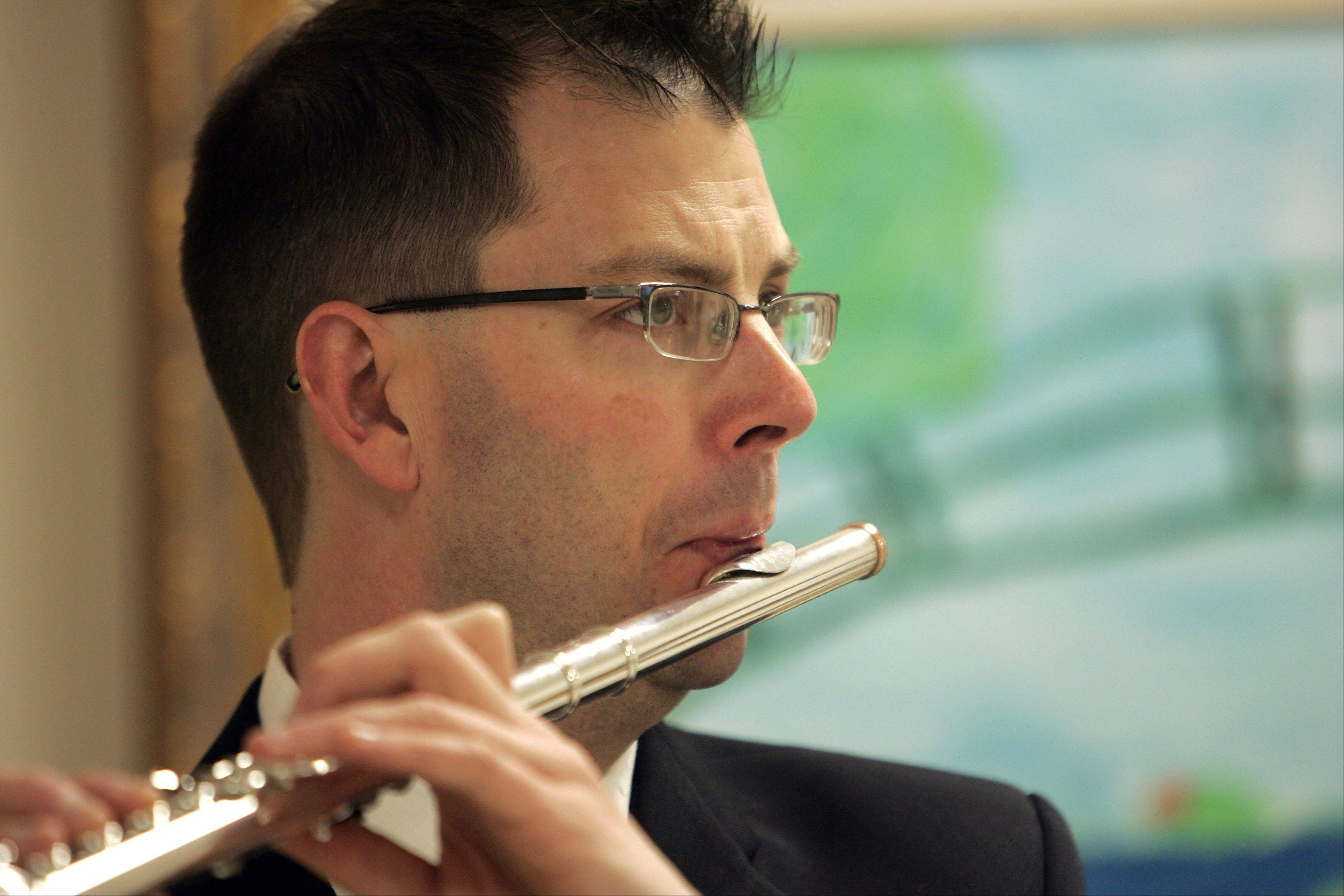 "Scott Metlicka, a flautist with the Elgin Symphony Orchestra, plays for patients at Sherman Hospital. Being part of the ESO's ""Musicians Care"" program is very rewarding, he said."