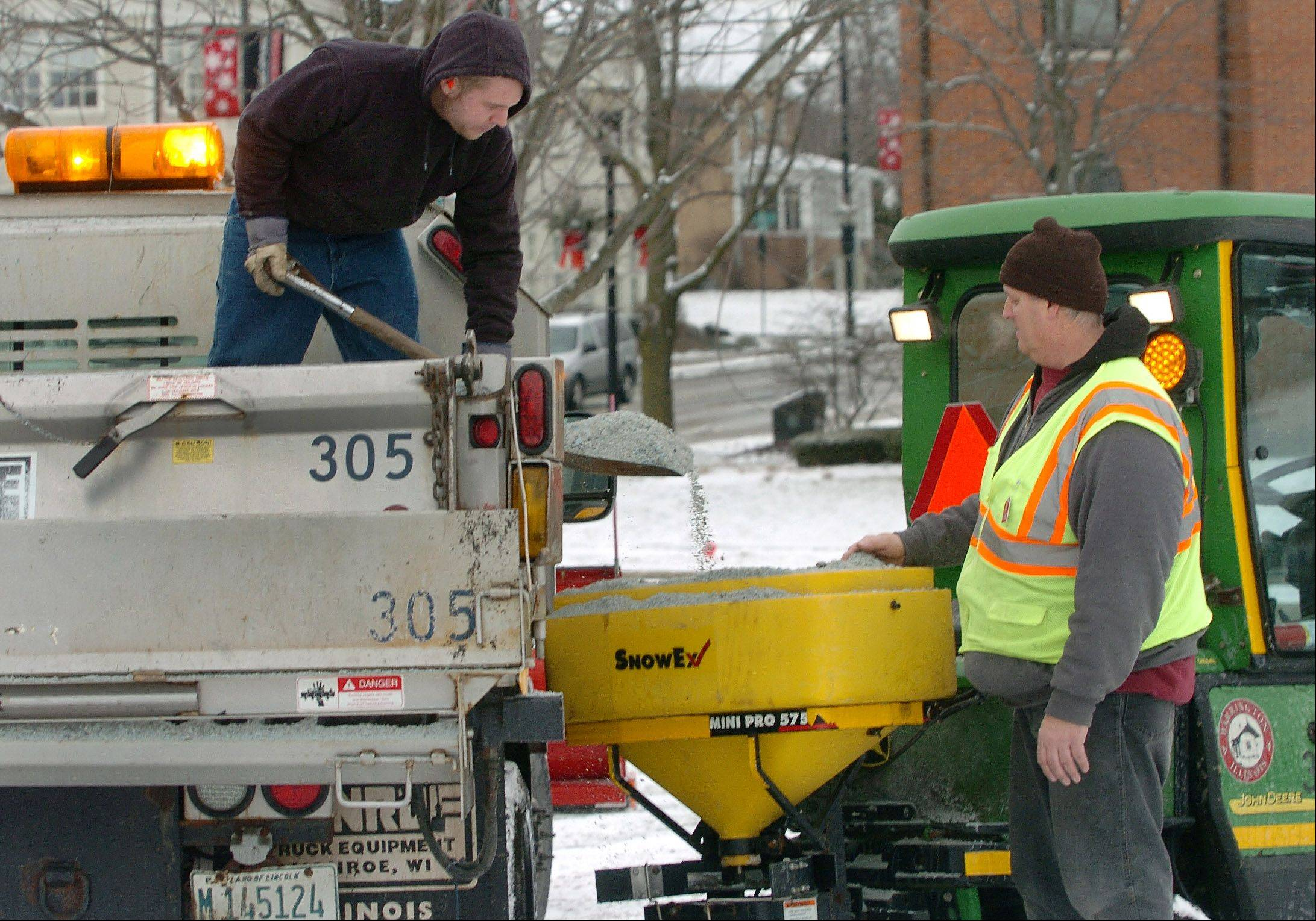 Barrington Public Works workers Ian Hooderhyde, left, and Kenneth Kellner were busy Friday salting the roads after an early morning snow.