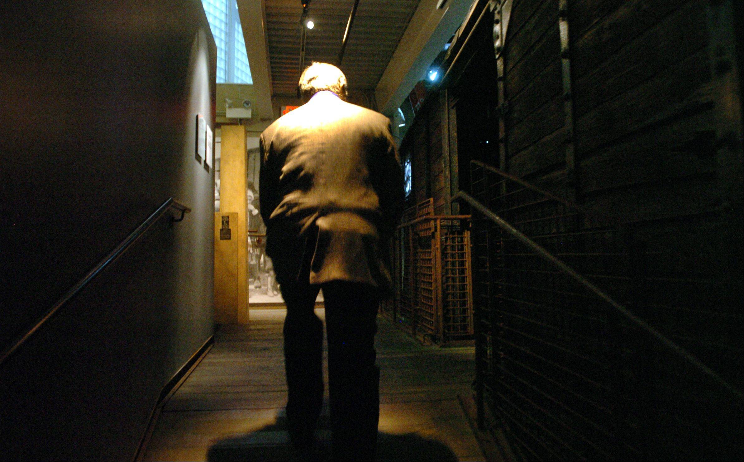Paluch walks up the ramp that leads to the German rail car at the Illinois Holocaust Museum & Education Center in Skokie, the type used in Nazi deportation programs.
