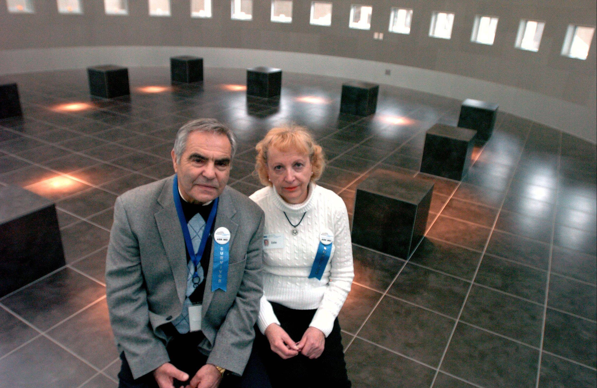 Holocaust survivors Adam Paluch of Mundelein and his twin sister Ida Kersz of Skokie sit in the Pritzker Hall of Reflection at the Illinois Holocaust Museum & Education Center. The twins were separated during the Holocaust, and reunited in 1995.