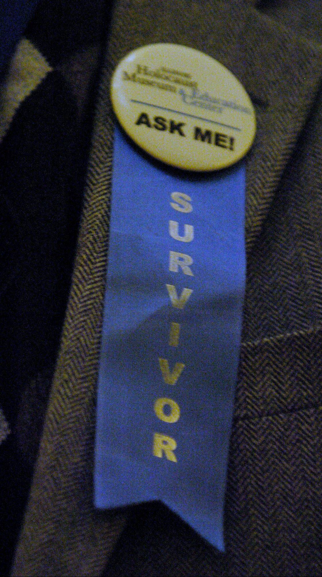 The blue ribbon that Adam Paluch of Mundelein wears proudly, signifying that he is a Holocaust survivor.