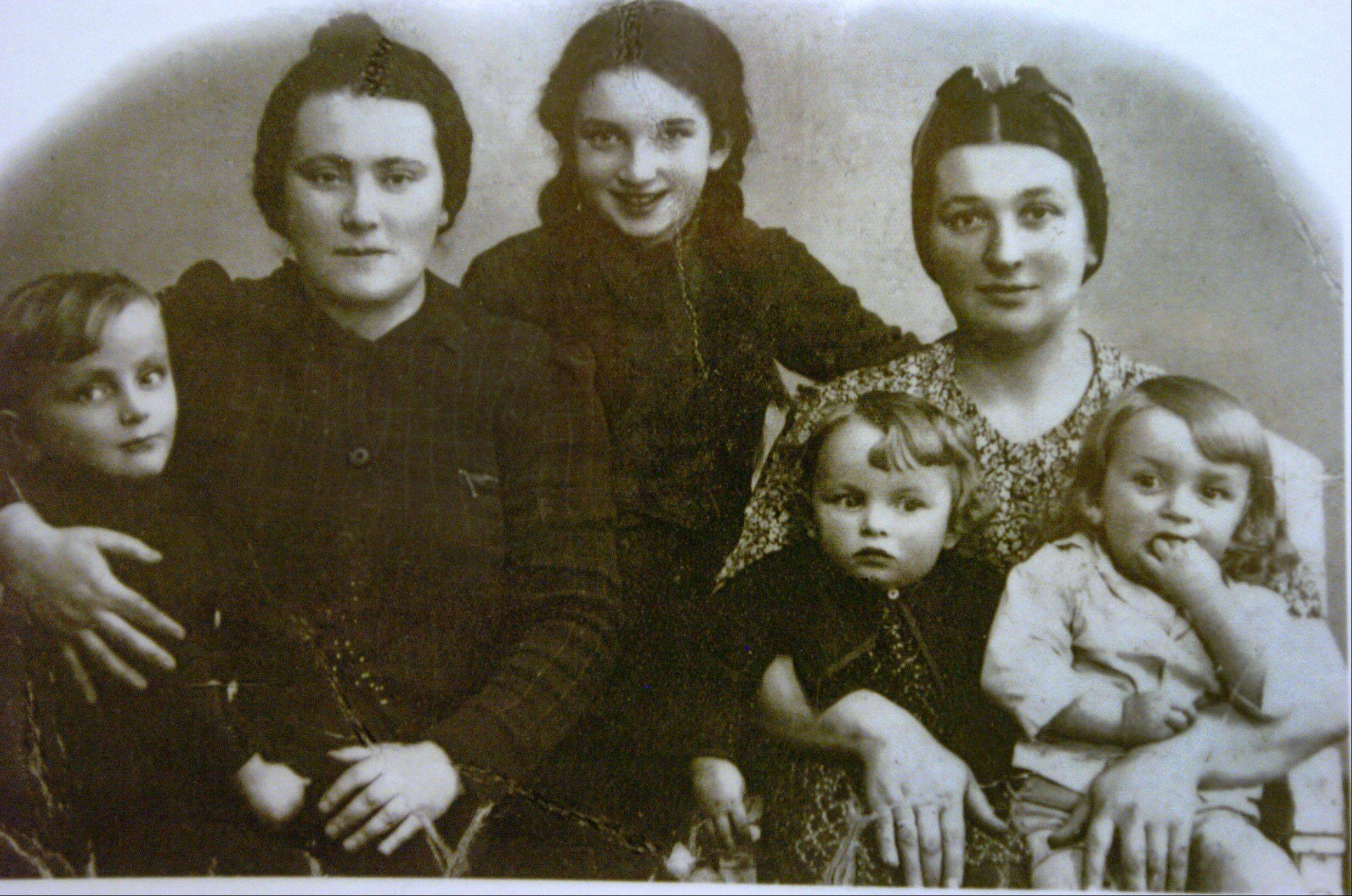 An old family picture of Adam Paluch, far right, sitting on his mother's lap with his twin sister Ida.