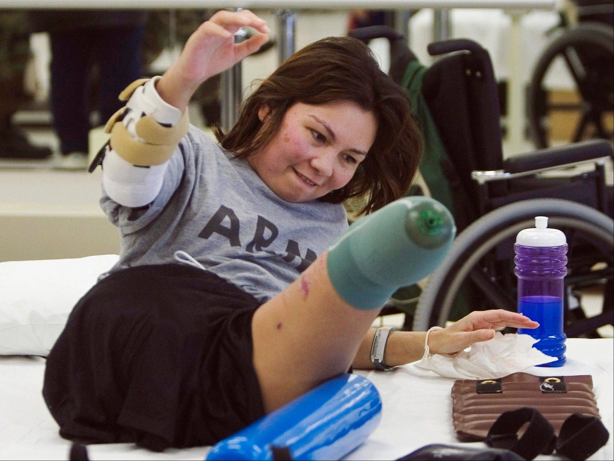 Jan. 31, 2005: Army Major Tammy Duckworth rolls herself up during physical therapy at the Walter Reed Army Medical Center in Washington. Duckworth lost both legs when the helicopter she was in was struck by a rocket-propelled grenade during a mission near Baghdad on Nov. 12, 2004.