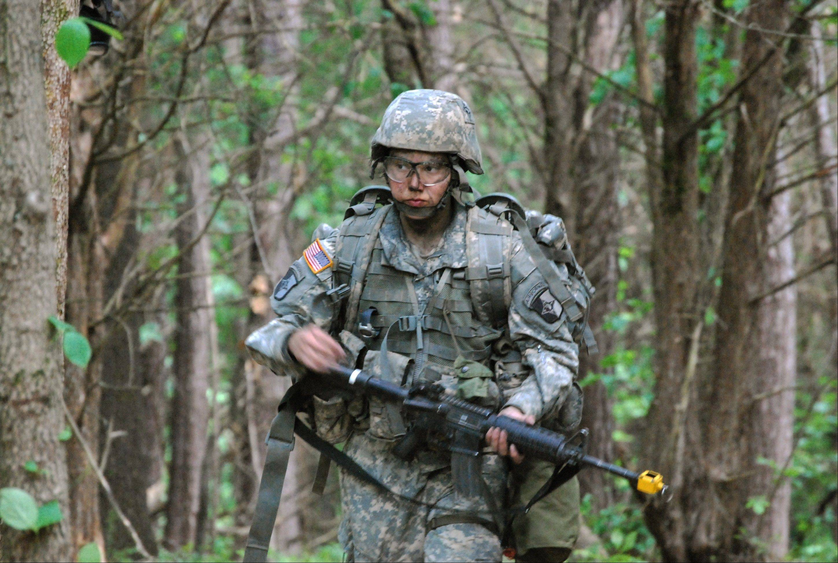 May 9, 2012: Capt. Sara Rodriguez of the 101st Airborne Division walks through the woods during the expert field medical badge testing at Fort Campbell, Ky.