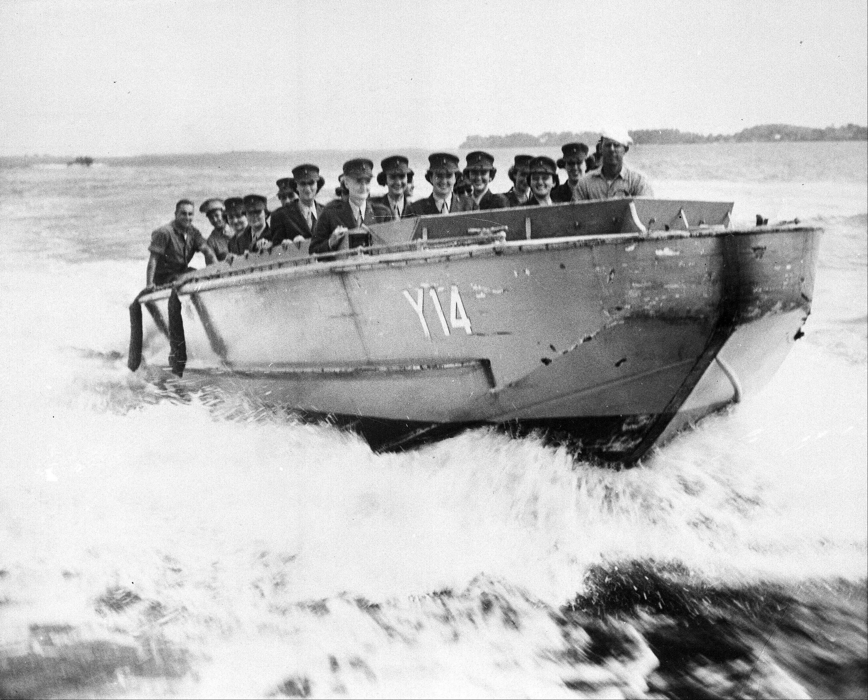 Oct. 2, 1943: Marine Corps Women Reserves undergoing training at Camp Lejeune, New River, N.C., ride in a landing boat of the type that were used by the Marines in landing operations in the South Pacific.