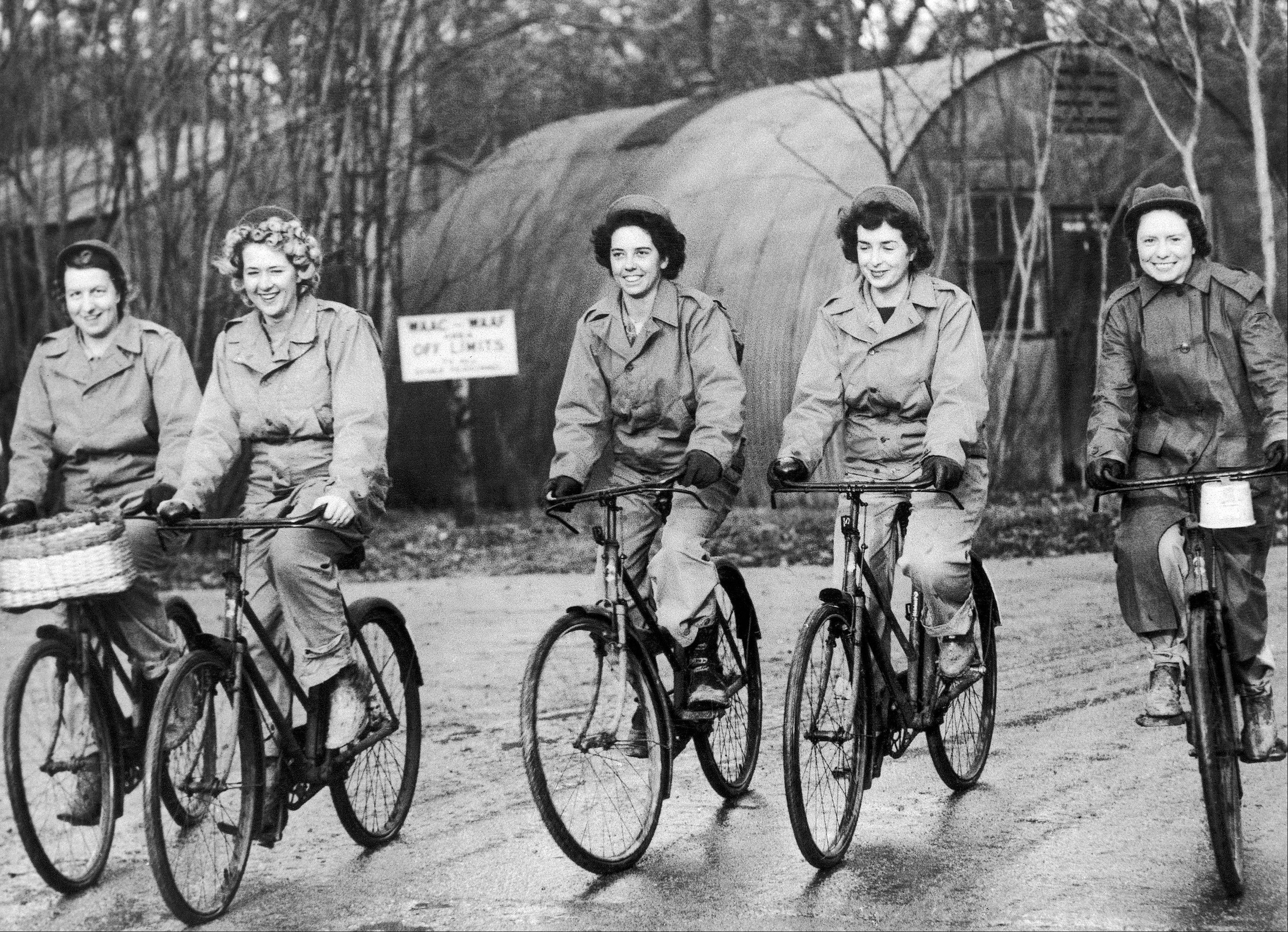 Dec. 22, 1943: Members of the Women Army Corps (WAC) stationed at a U.S. medium bomber station in England, ride bicycles on their way to work.