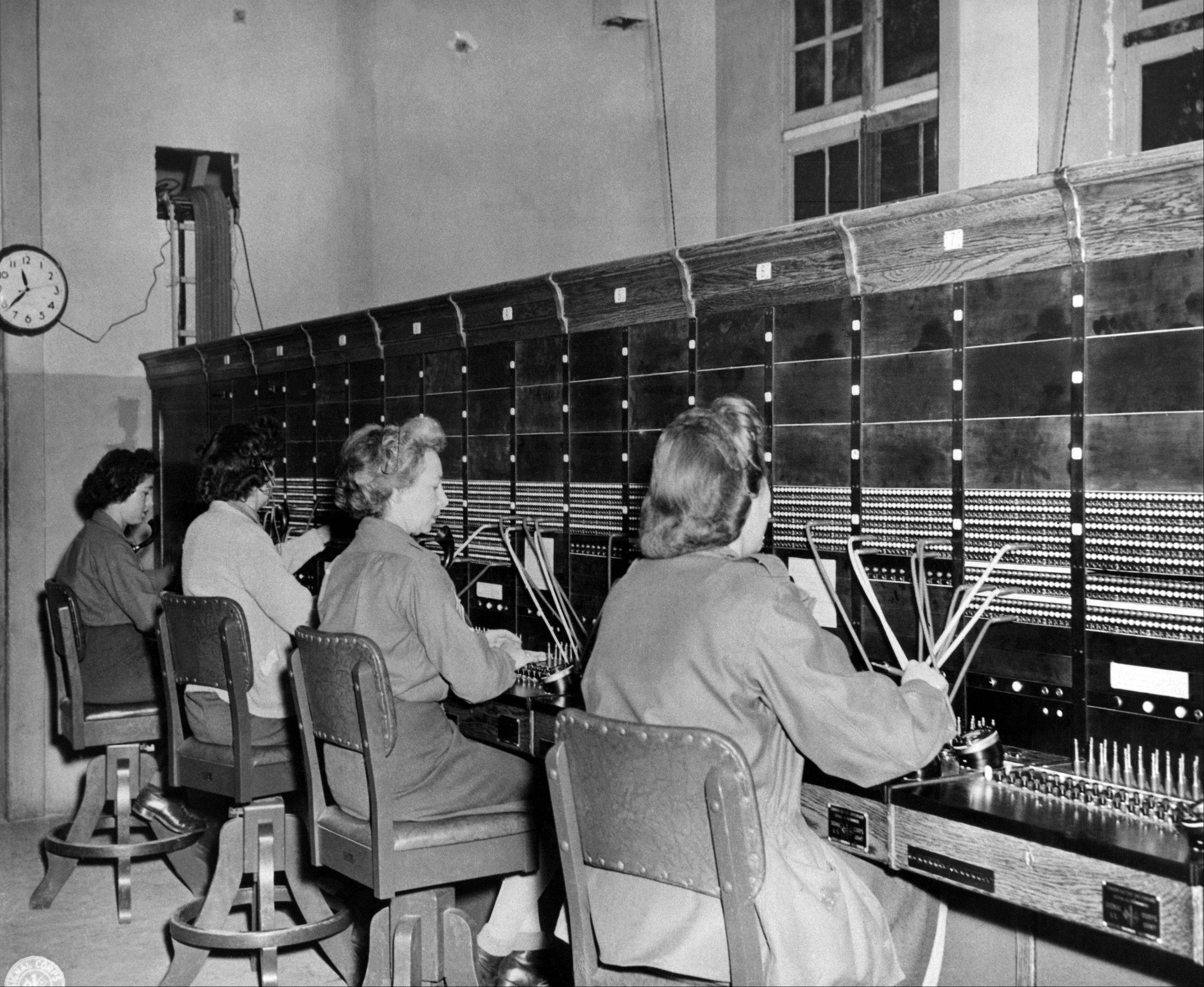 Oct. 7, 1944: Women Army Corps (WAC) switchboard operators put military calls through at their base in France.
