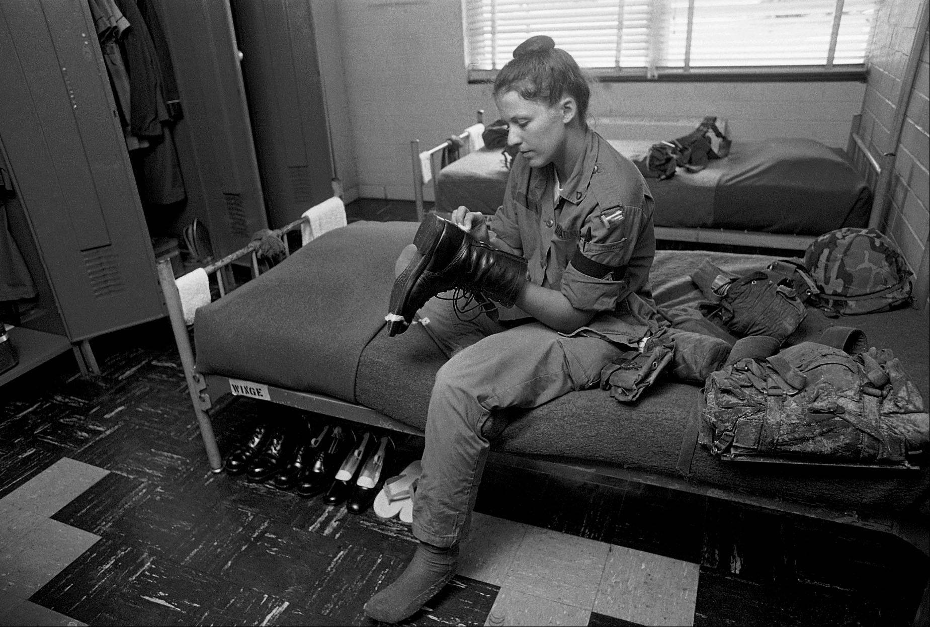 Sept. 21, 1977: Recruit Angelia Wingle, of Lyons Ga., shines her combat boot as she sits on a bunk in the barracks at Fort Jackson, S.C.