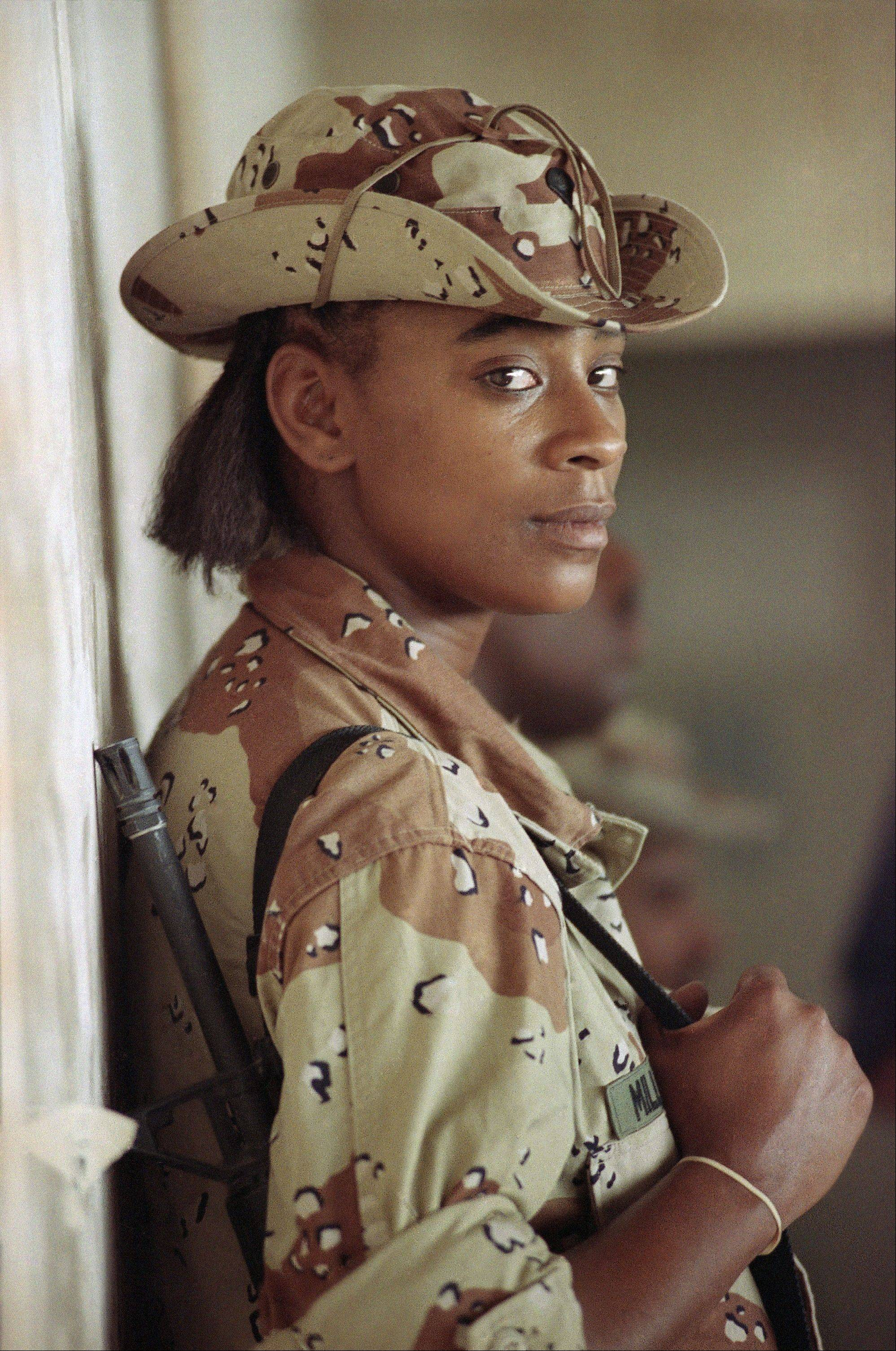 Sept. 3, 1990: U.S. Army Spec. Tanya Miller of New York., leans against a wall on an air base in Saudi Arabia. Miller was in Saudi Arabia with the 101st Airborne Divsion in support of Operation Desert Shield.