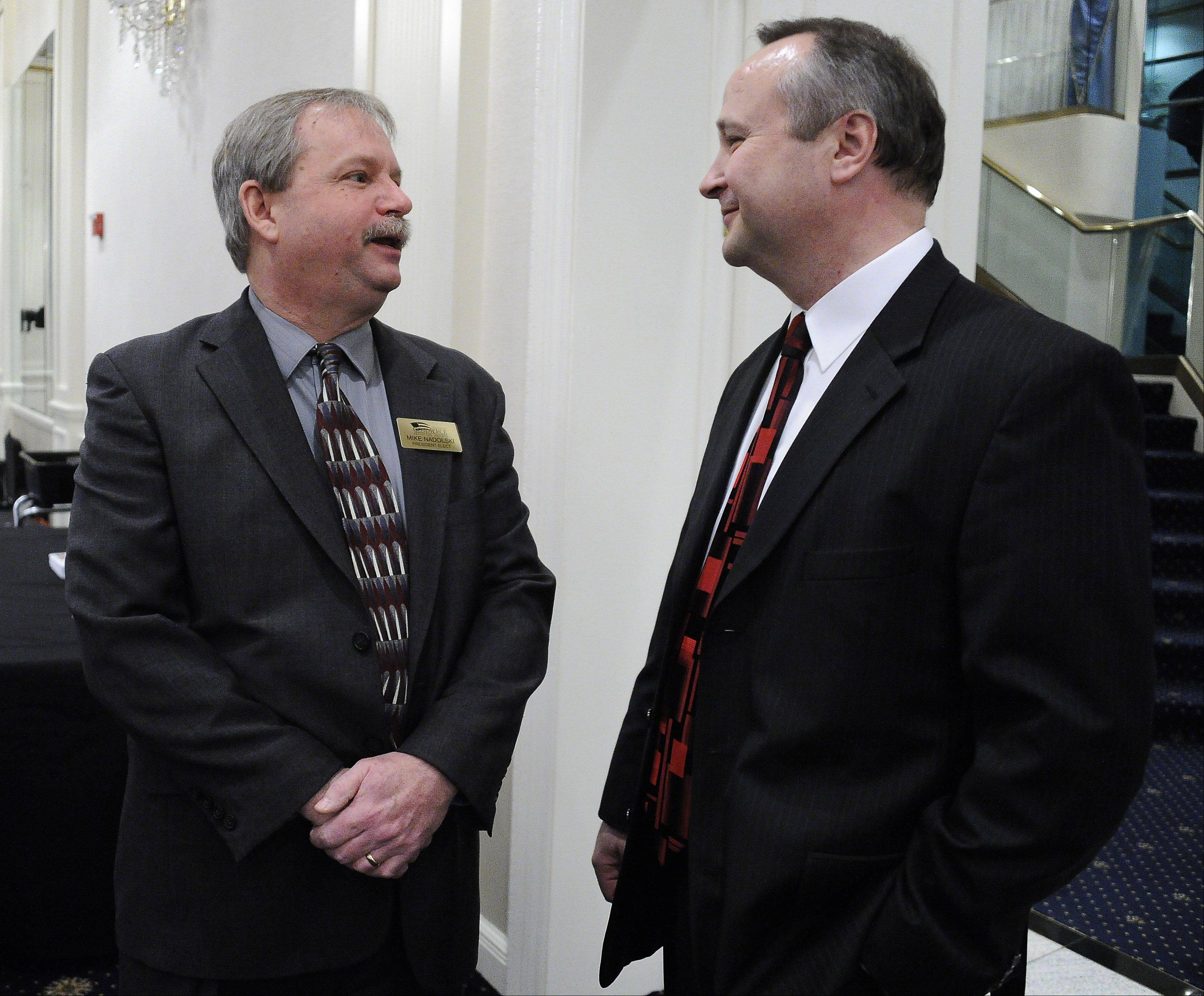 Chamber Executive Director Jon Ridler, right, talks with Mike Nadolski of Visual Enterprise Systems Inc. of Arlington Heights at the annual Arlington Heights Chamber of Commerce dinner on Thursday. Nadolski was named Business Leader of the Year.