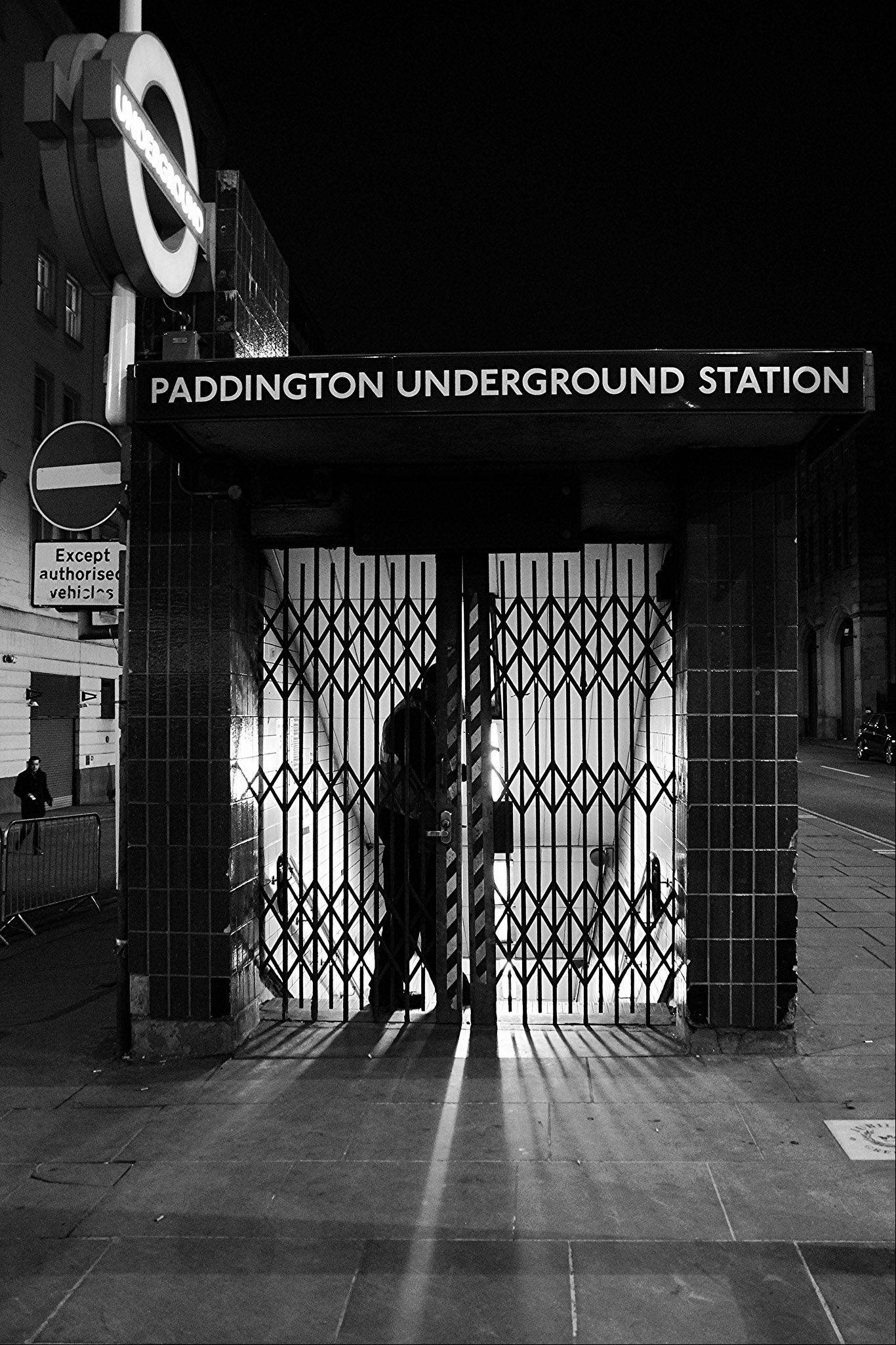 This was taken in London on the 150th Anniversary of the London Underground. The maintenance man is locking the gate to the Paddington Underground Station. I really liked the night scene and the dramatic shadows in the image. I call it �Locking Up The Underground�
