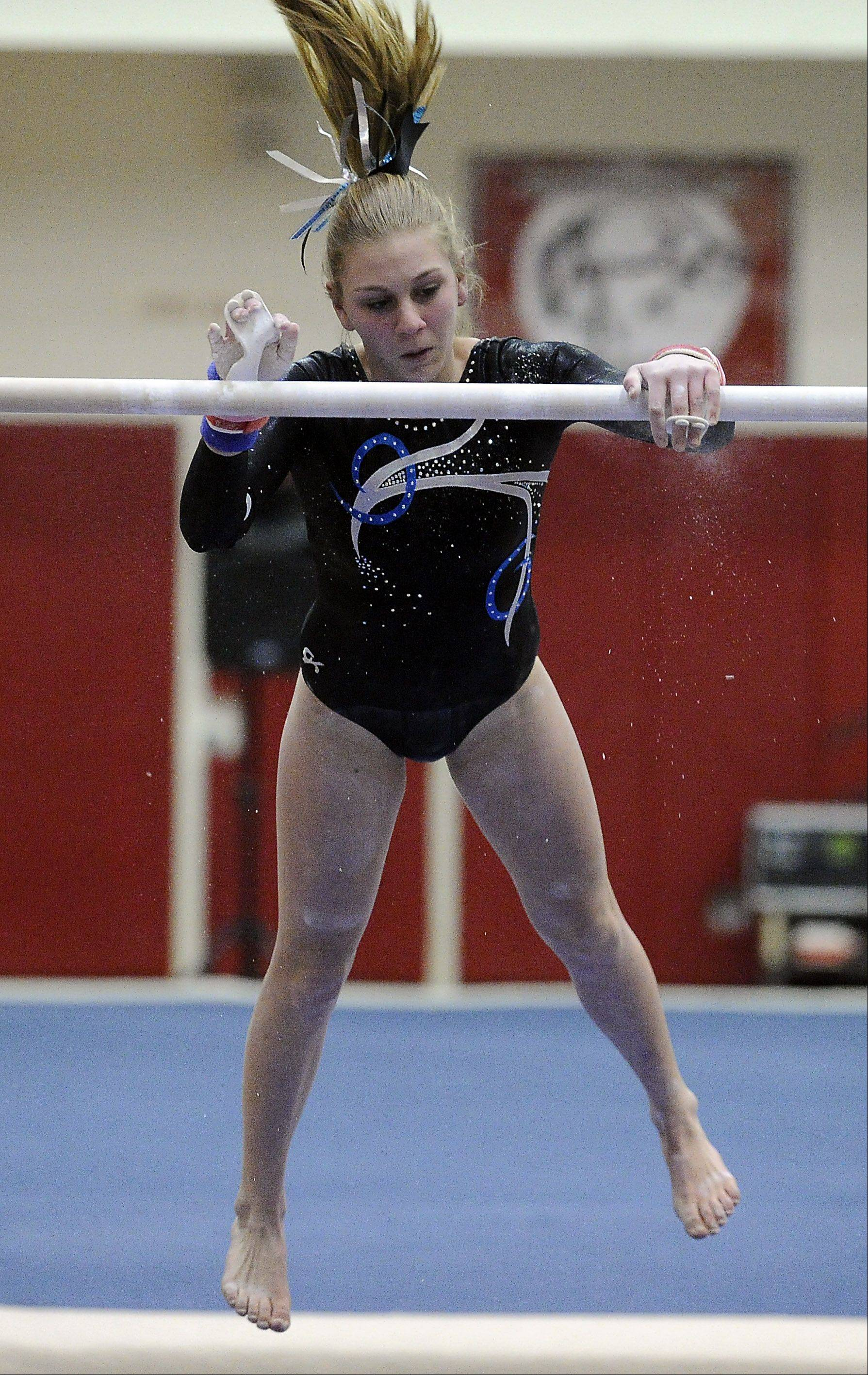 Prospect's Maddie Boldt on the uneven parallel bars at the Mid-Suburban League meet at Palatine on Friday.