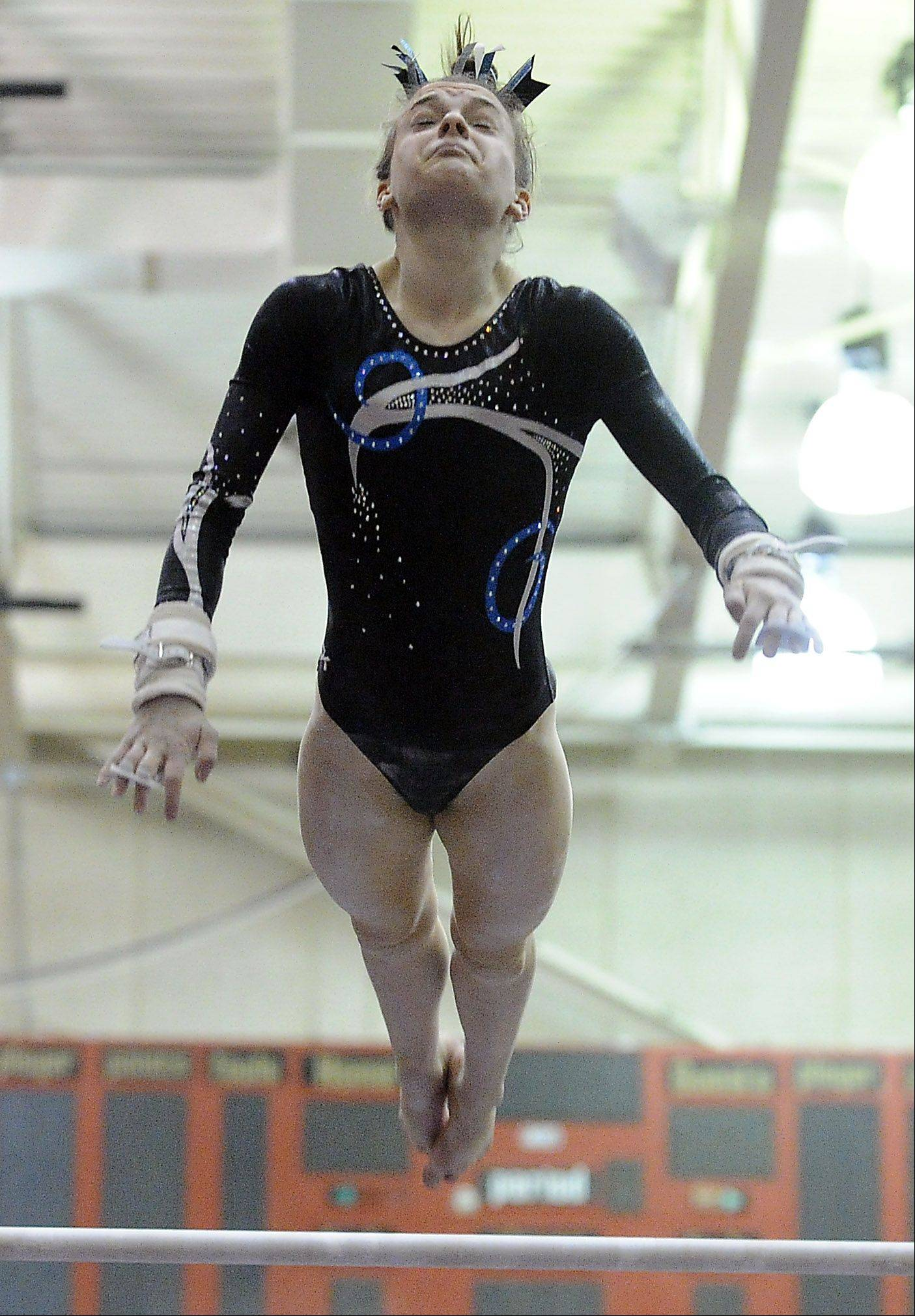 Prospect's Maddie Larock on the uneven parallel bars at the Mid-Suburban League meet at Palatine on Friday.