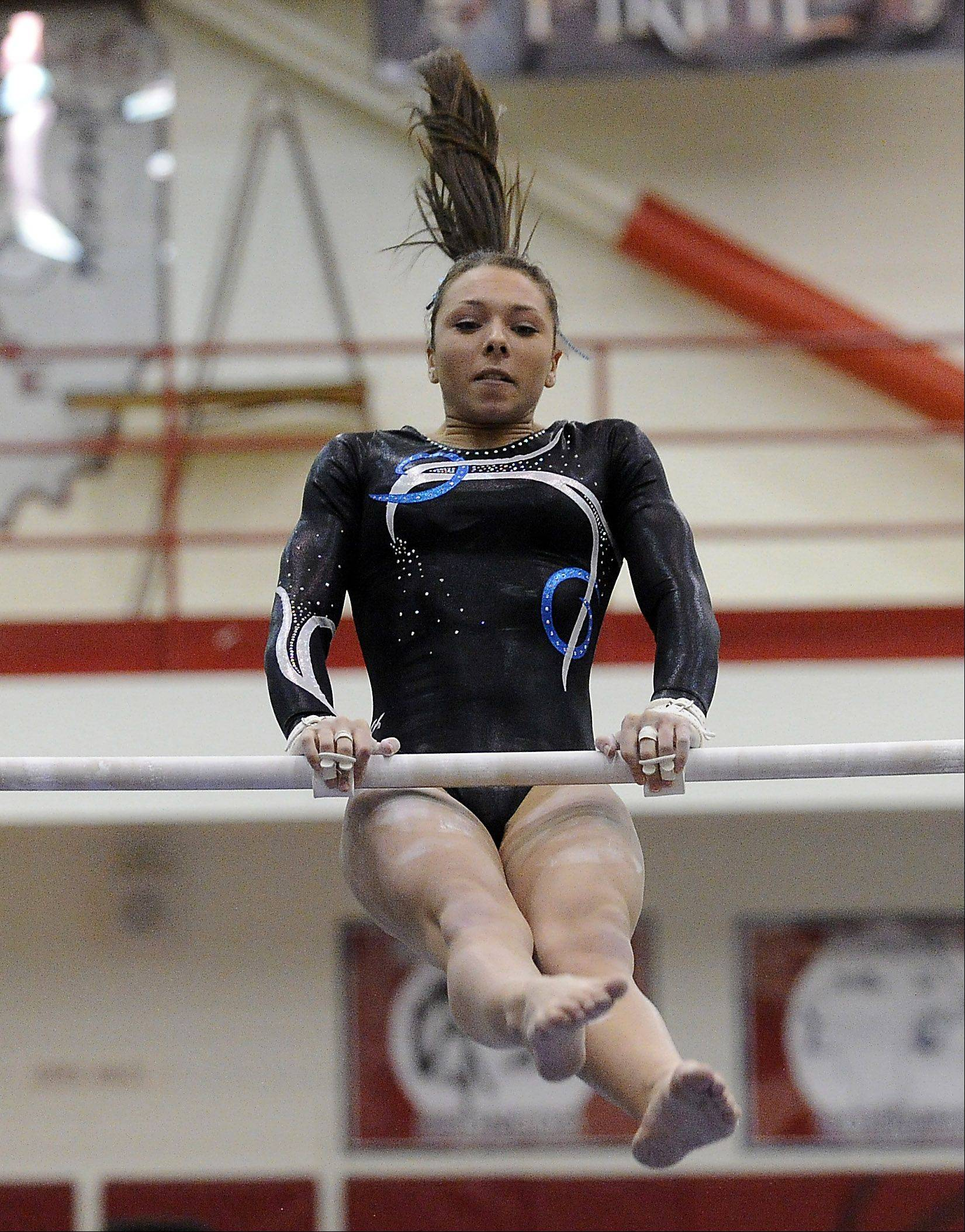 Prospect's Gianna Scala on the uneven parallel bars at the Mid-Suburban League meet at Palatine on Friday.