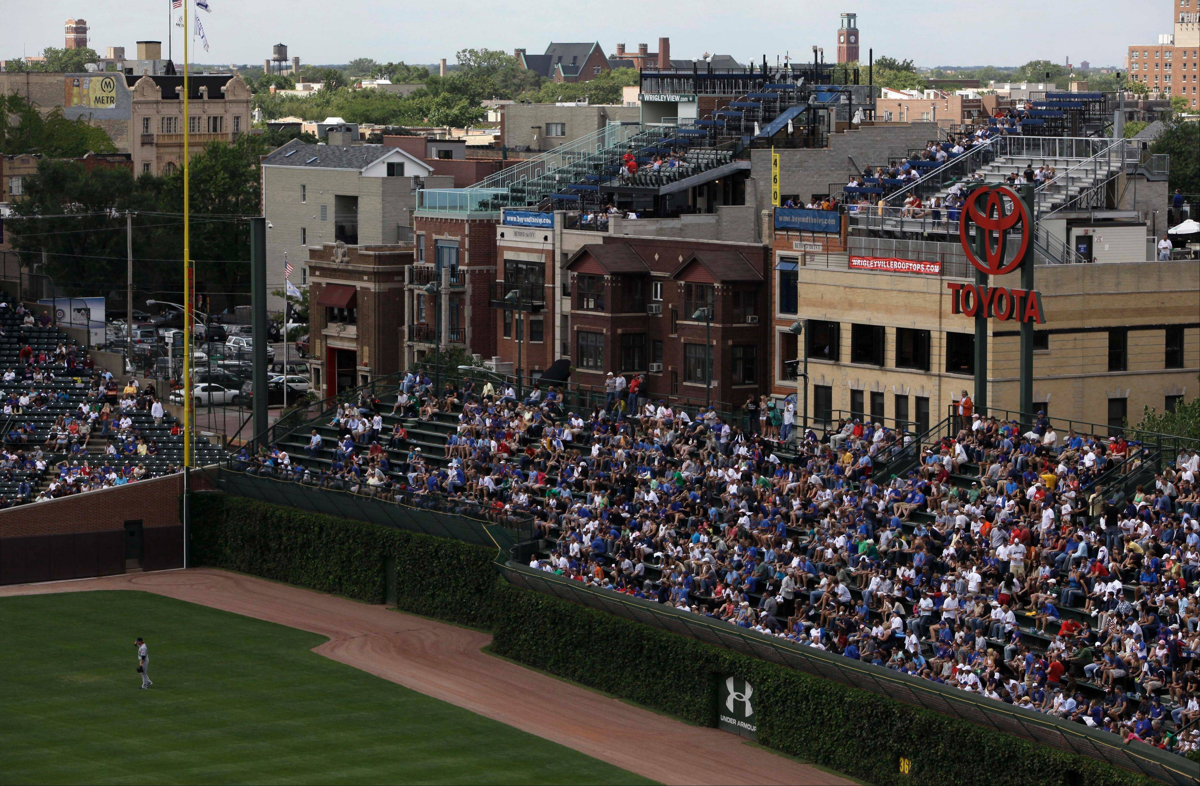 Members of the Wrigleyville Rooftop Association, responding to a proposal by the Cubs calling for the city to lift some landmark restrictions as part of a plan to renovate Wrigley Field, have come out with their own proposal. They want to see digital signs installed to raise revenue for the Cubs, city and community in exchange for protecting their views of the historic ballpark.