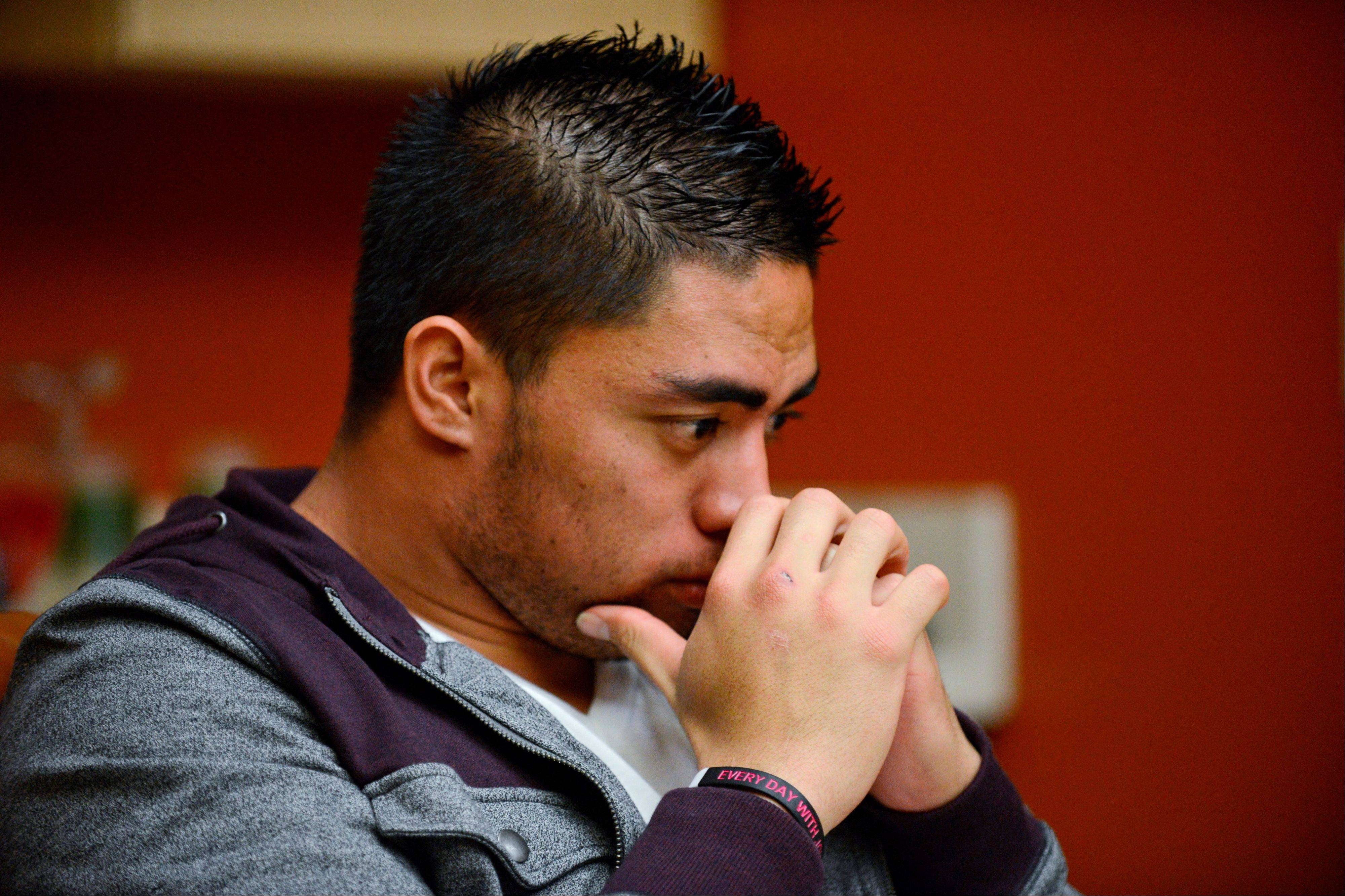 In a photo provided by ESPN, Notre Dame linebacker Manti Te'o pauses during an interview with ESPN last week in Bradenton, Fla.