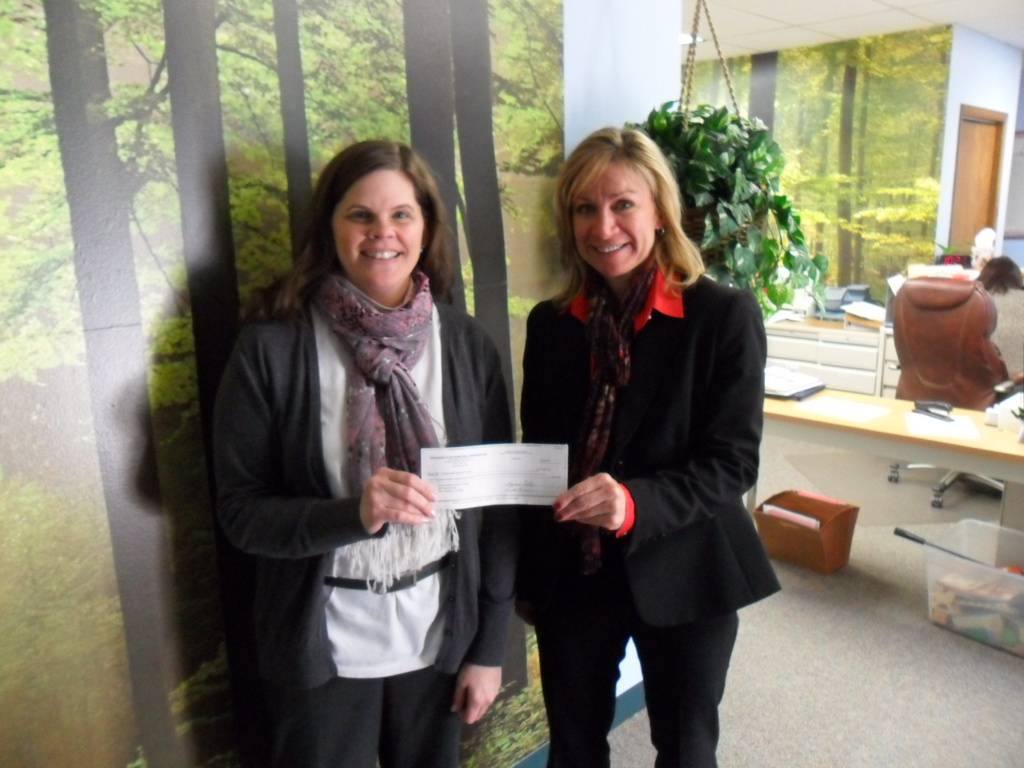 Kristin Maxwell, HSP's Assistant Director, receiving donation from Exchange Club of Naperville member, Anna Zimmerman.