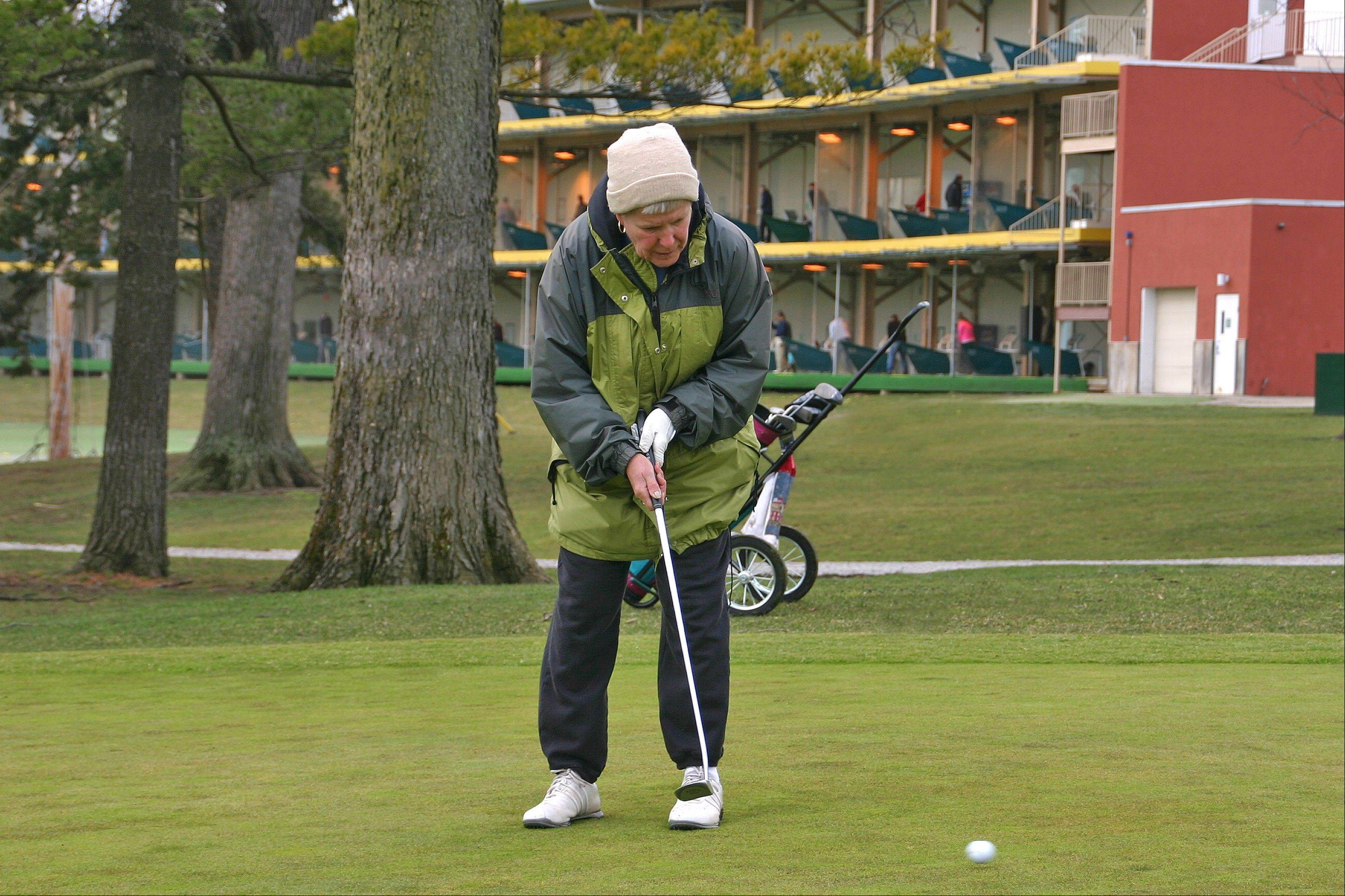 Marcheta Decoran sinks her final putt for a score of 46 at the 2013 Des Plaines Park District Chili Open.