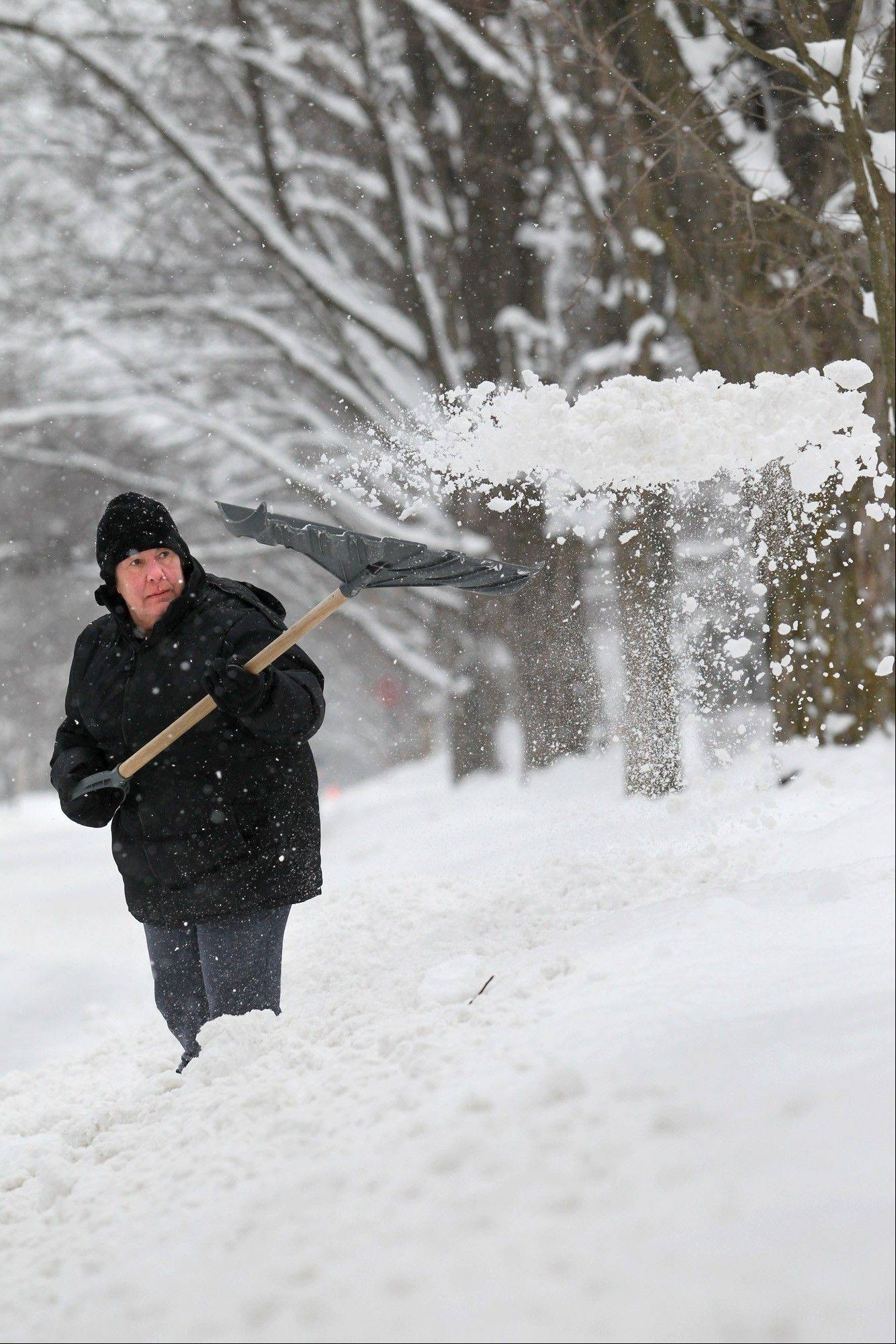 Katherine Sleder shovels her driveway Friday outside her home in Traverse City, Mich. �It�s like we�re getting all our winter in one week,� said Sleder. Snow accumulation is below normal across the Upper Midwest for the second consecutive winter. It�s picked up over the past week as temperatures have fallen dramatically.