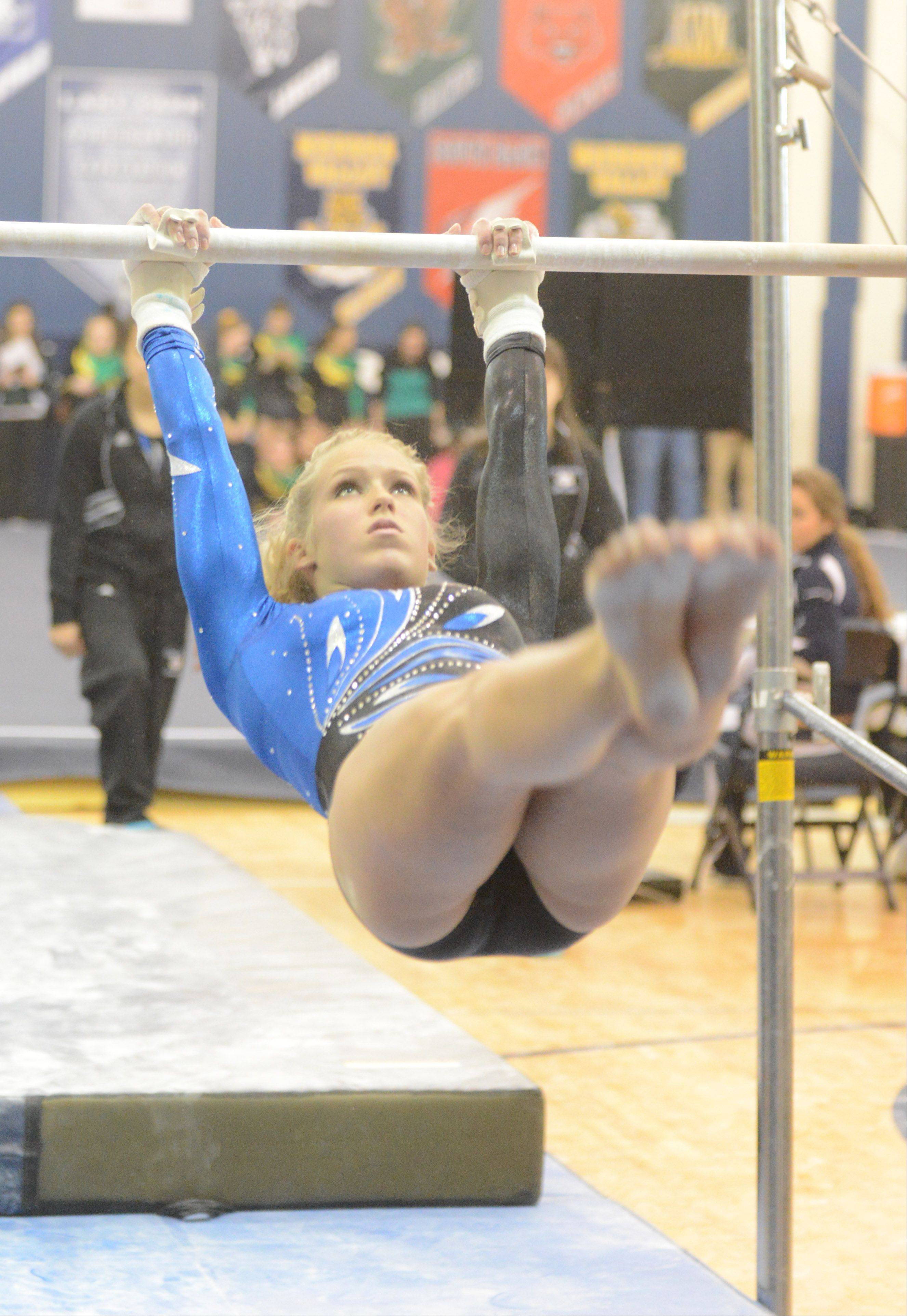 McKenna Merges of Geneva on the bars during the Upstate Eight gymnastics meet at Lake Park East Saturday.