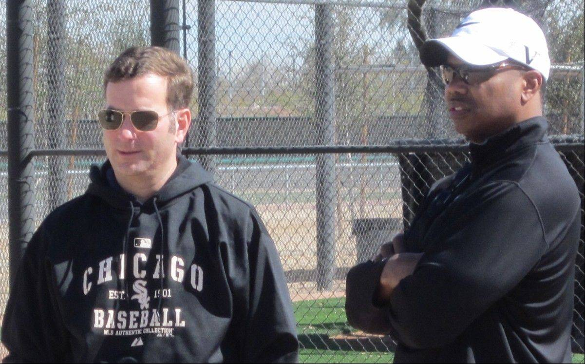 White Sox GM Rick Hahn, left, and former GM Ken Williams, survey the activity at spring training last year.