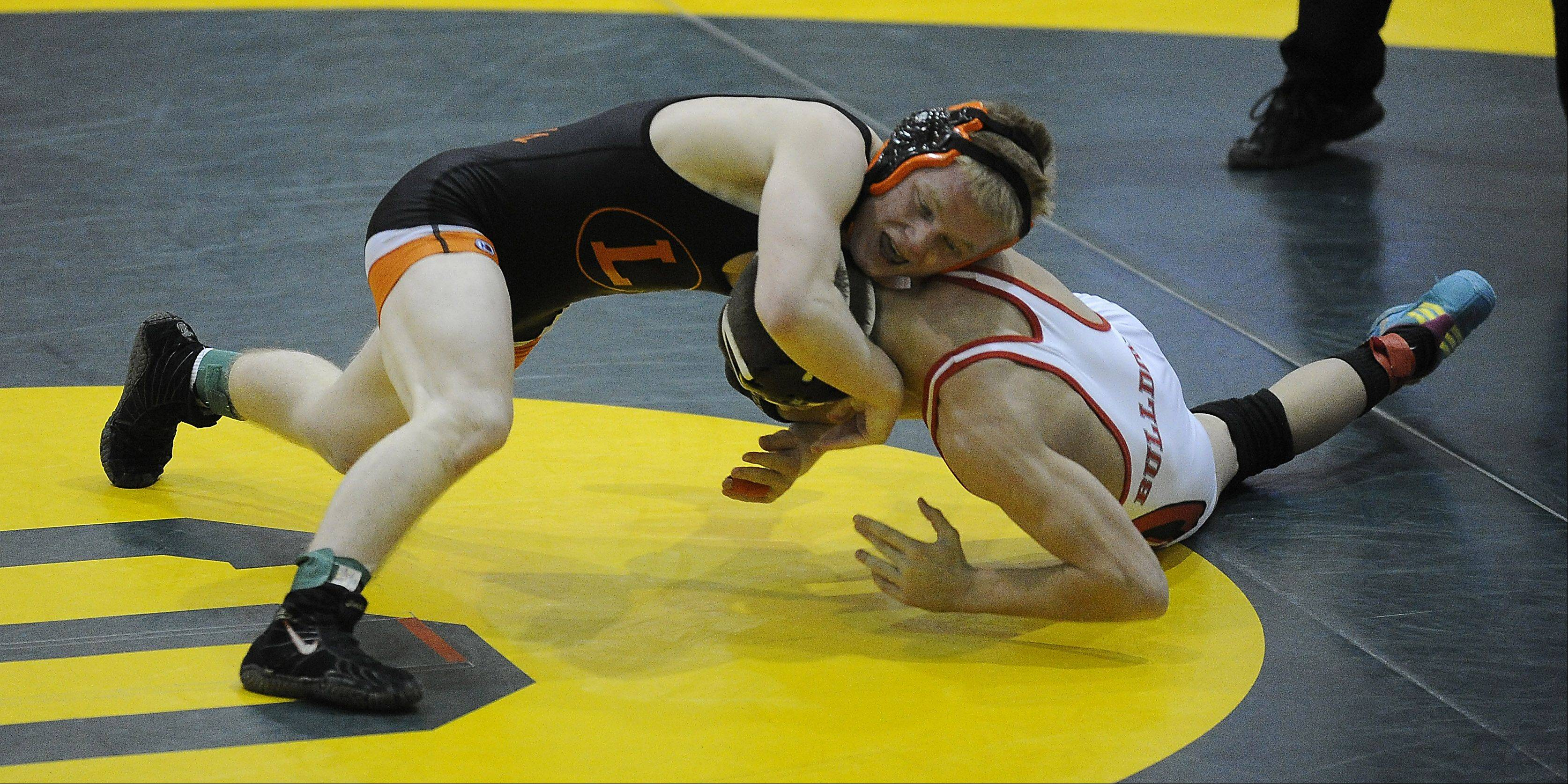 Libertyville�s Steve Polakowski makes a move on Grant�s Troy Parent on his way to a win at 120 pounds in the North Suburban Conference championship at Stevenson on Saturday.